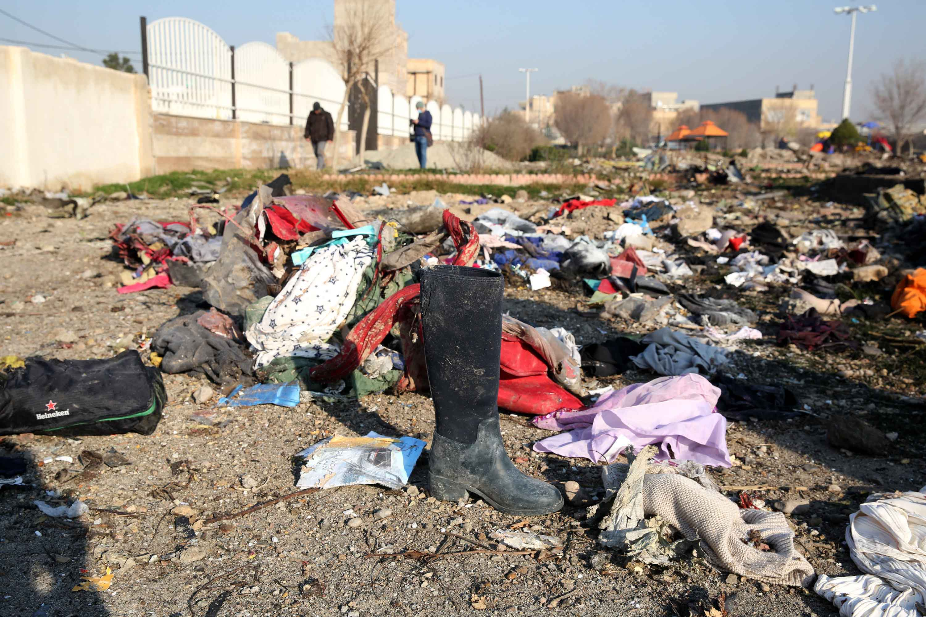 Victims' possessions are seen scattered at the crash site.