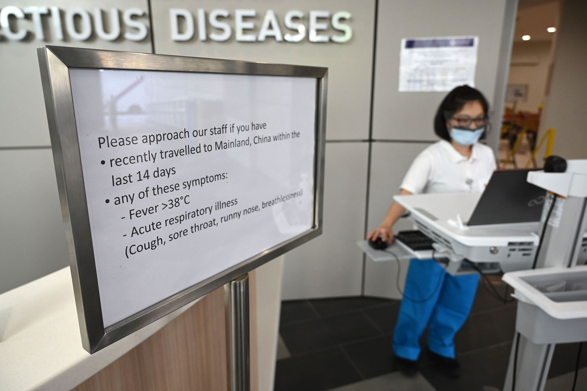 Medical staff prepare pre screening procedure at the National Centre for Infectious Diseases building at Tan Tock Seng Hospital in Singapore.