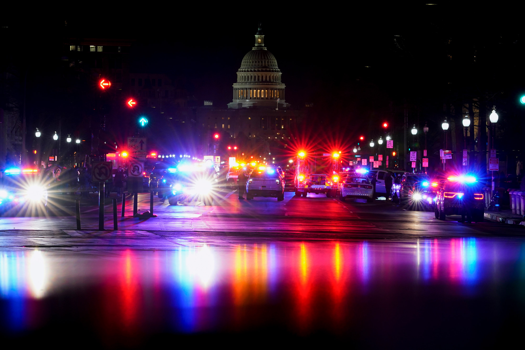 With the U.S. Capitol in the background, lights from police vehicles illuminate Pennsylvania Avenue in Washington, DC, on January 6.