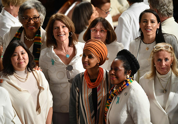 Representative from Minnesota Ilhan Omar and Democratic members from the House of Representatives wearing white attend the State Of The Union address at the US Capitol in Washington, DC, on February 4, 2020. (Photo by MANDEL NGAN / AFP) (Photo by MANDEL NGAN/AFP via Getty Images)