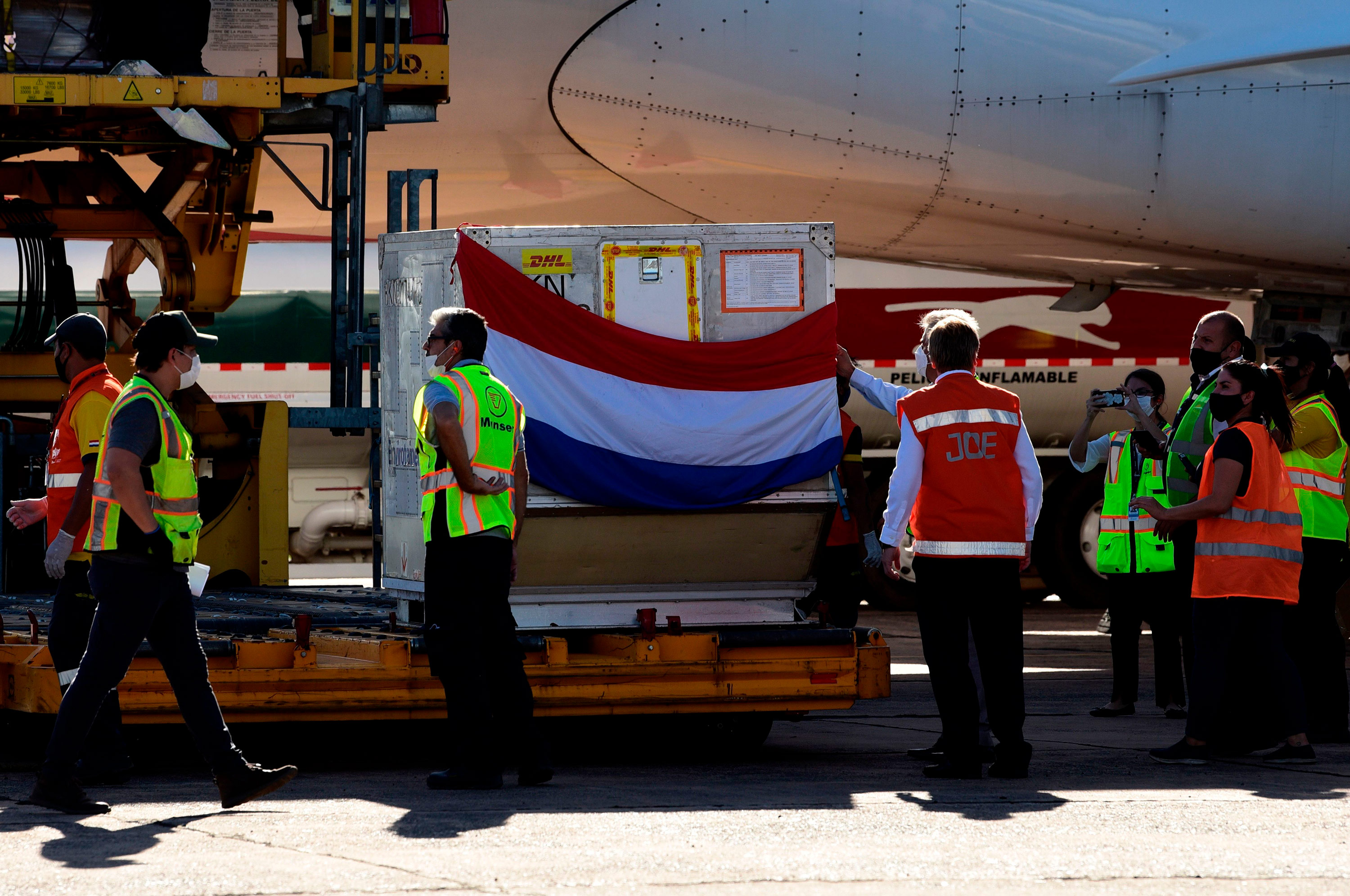 A batch of Russian Sputnik V coronavirus vaccines is unloaded from a plane at Silvio Pettirossi International Airport in Luque, Paraguay, on February 18.