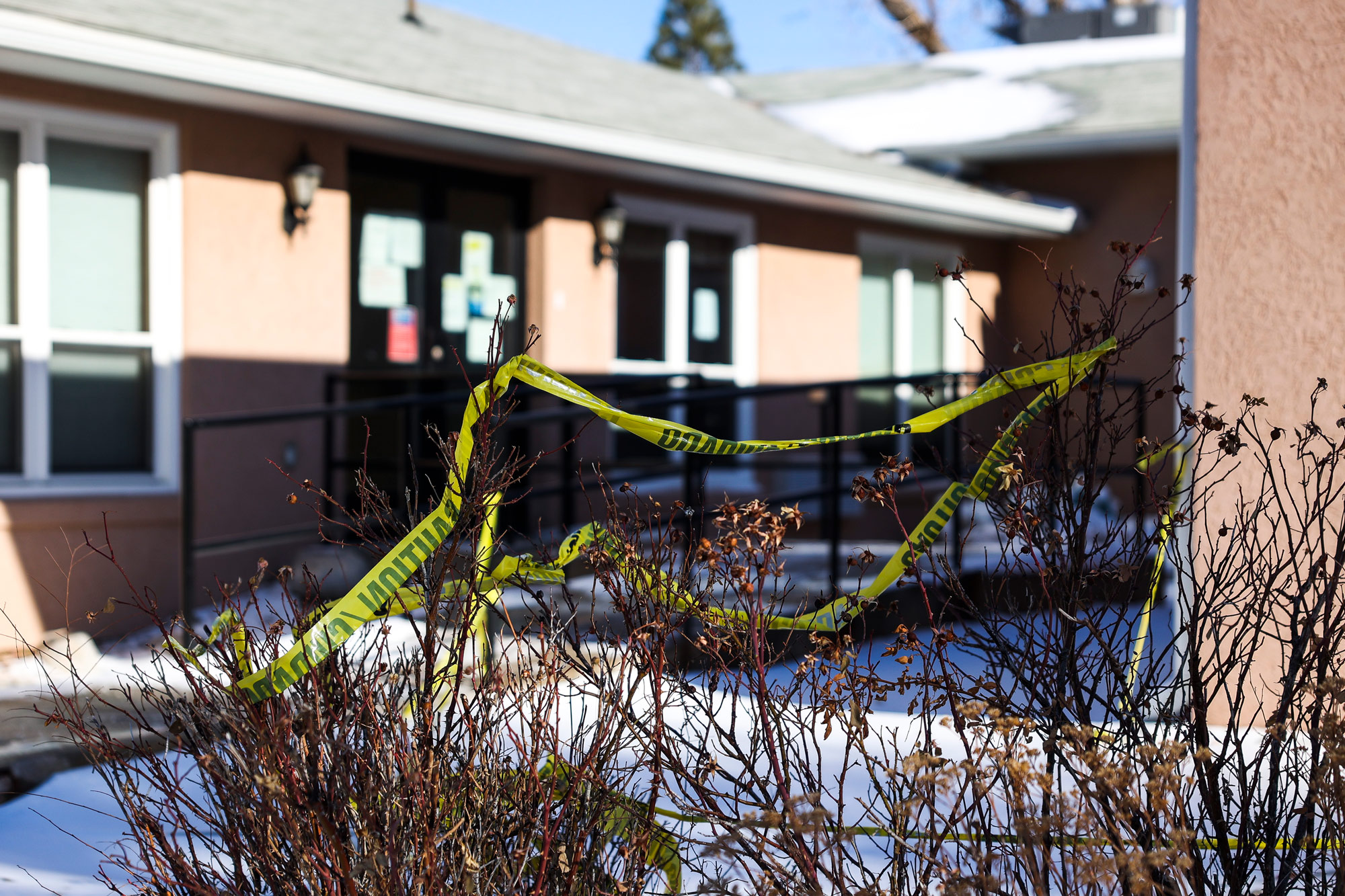 Caution tape sits in front of the Good Samaritan Society nursing home on December 30, 2020 in Simla, Colorado. A Colorado National Guard soldier who was deployed at an ongoing COVID outbreak at the nursing home tested positive for a COVID-19 variant.