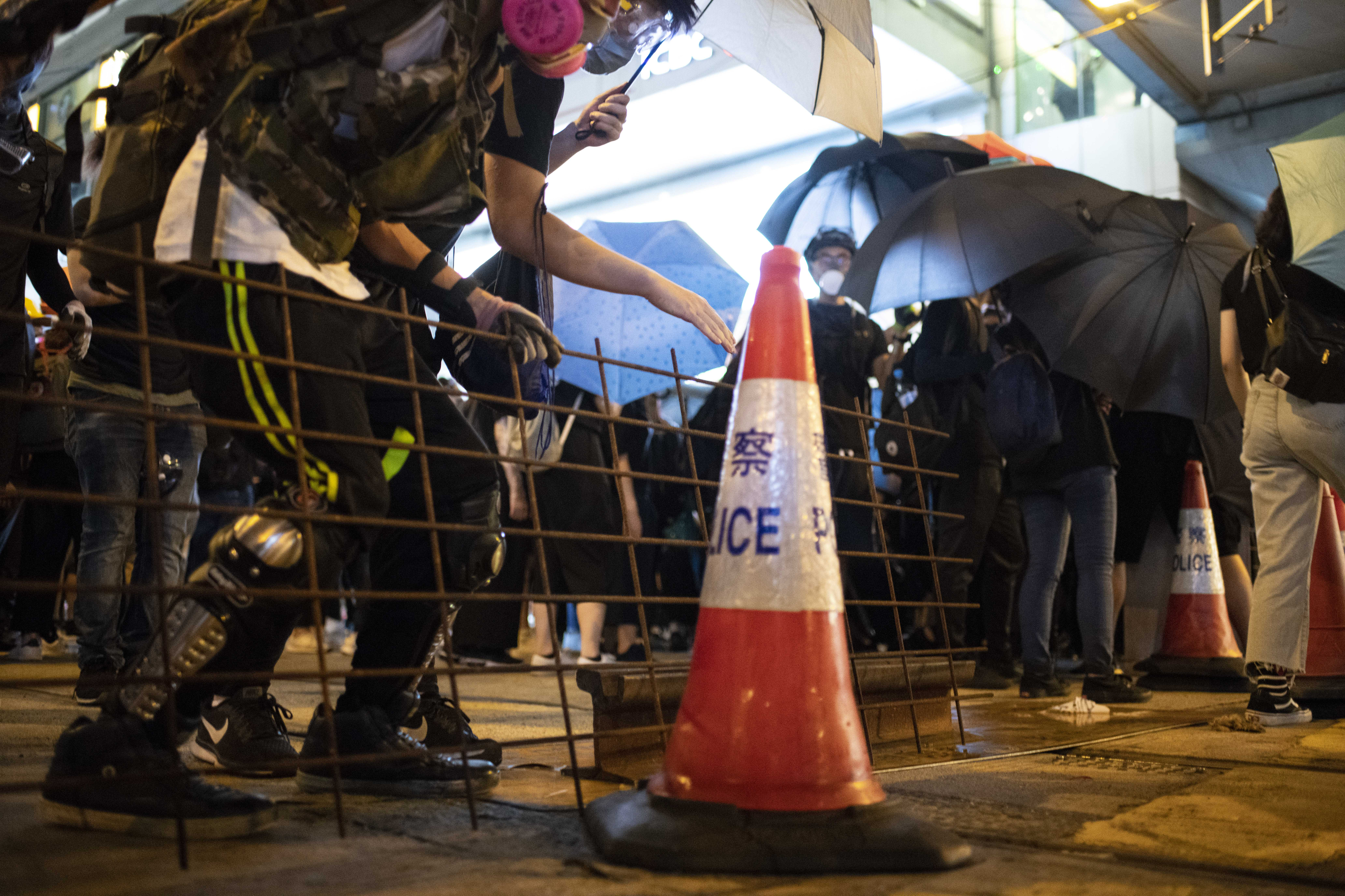 Protesters set impromptu barricades in Causeway Bay Sunday night.