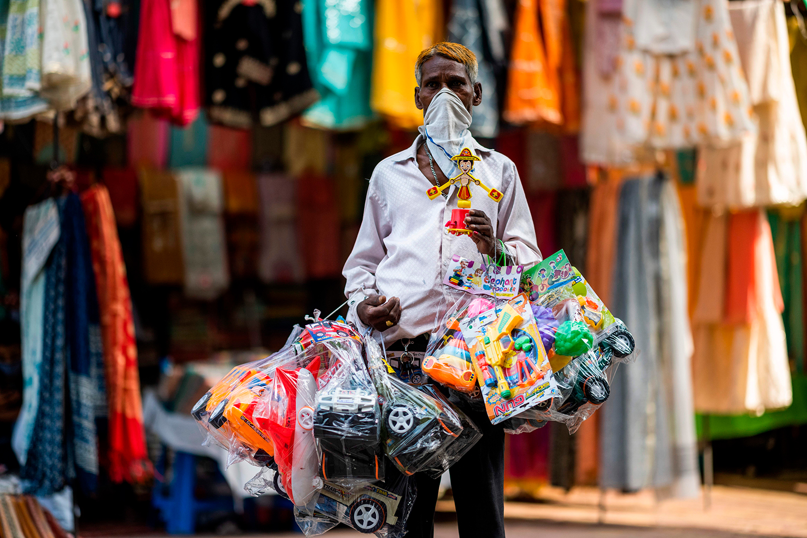 A vendor selling toys waits for customers in a market area in New Delhi on July 5.