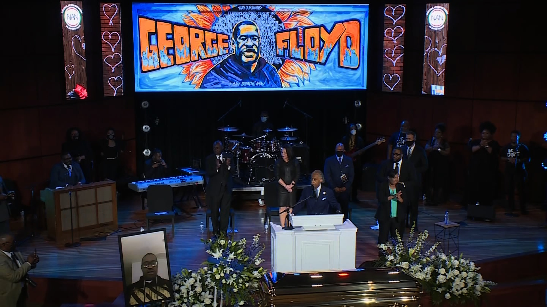 Rev. Al Sharpton speaks on stage at George Floyd's memorial service in Minneapolis, on June 4.