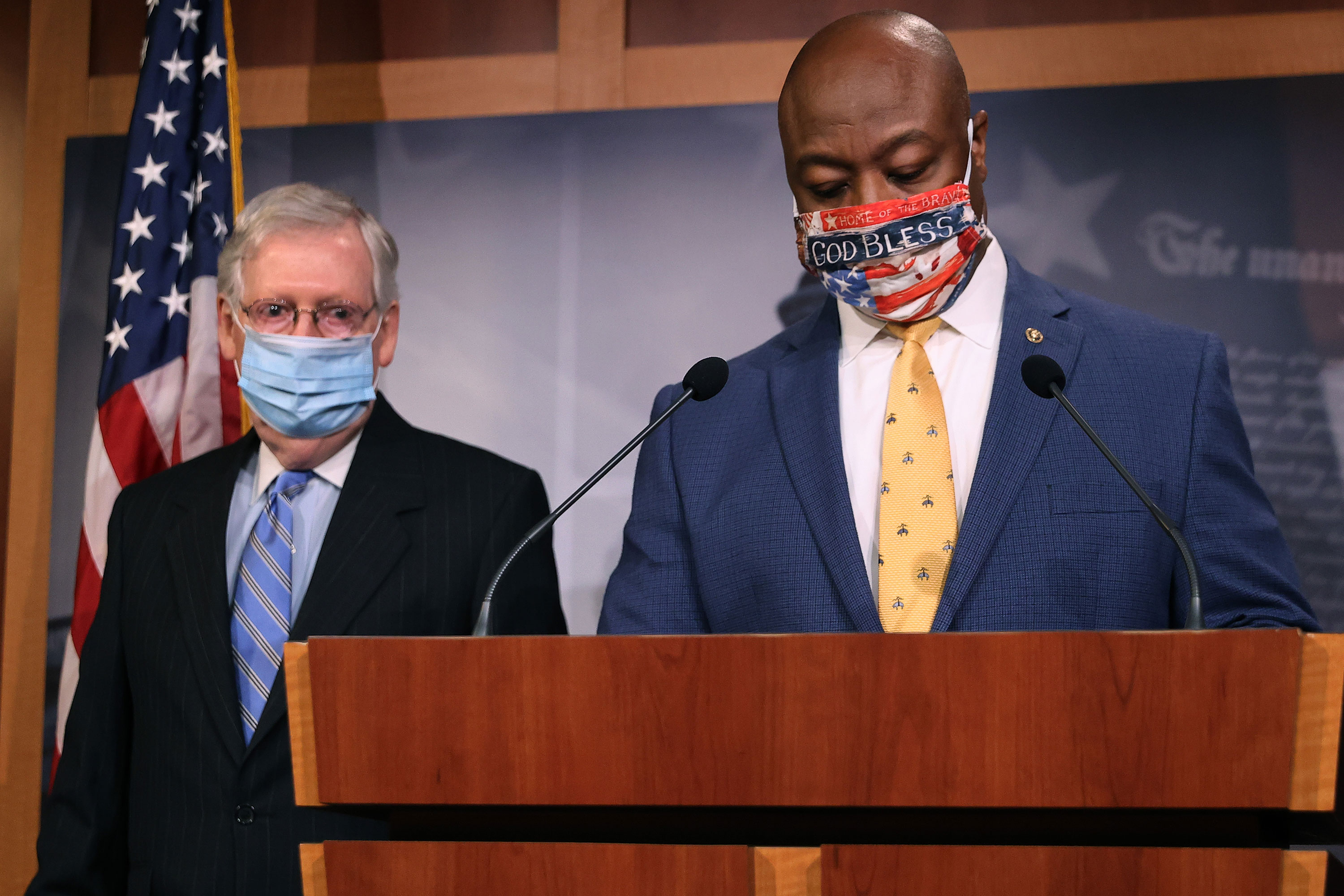 Sen. Tim Scott, right, and Senate Majority Leader Mitch McConnell take the podium for a news conference at the Capitol building in Washington on June 17.