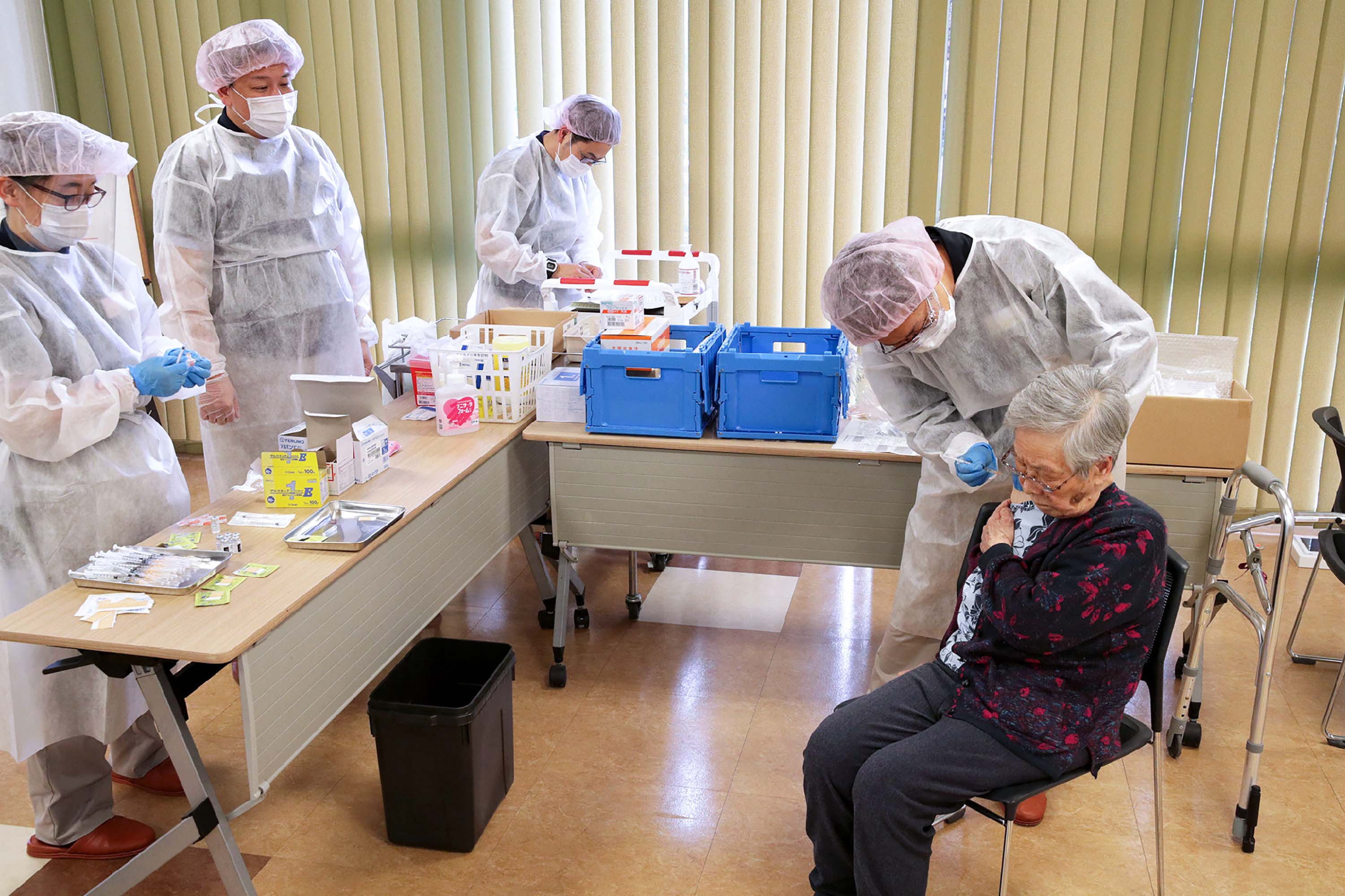 An elderly woman receives a dose of the Covid-19 vaccine in Tokyo on April 12.