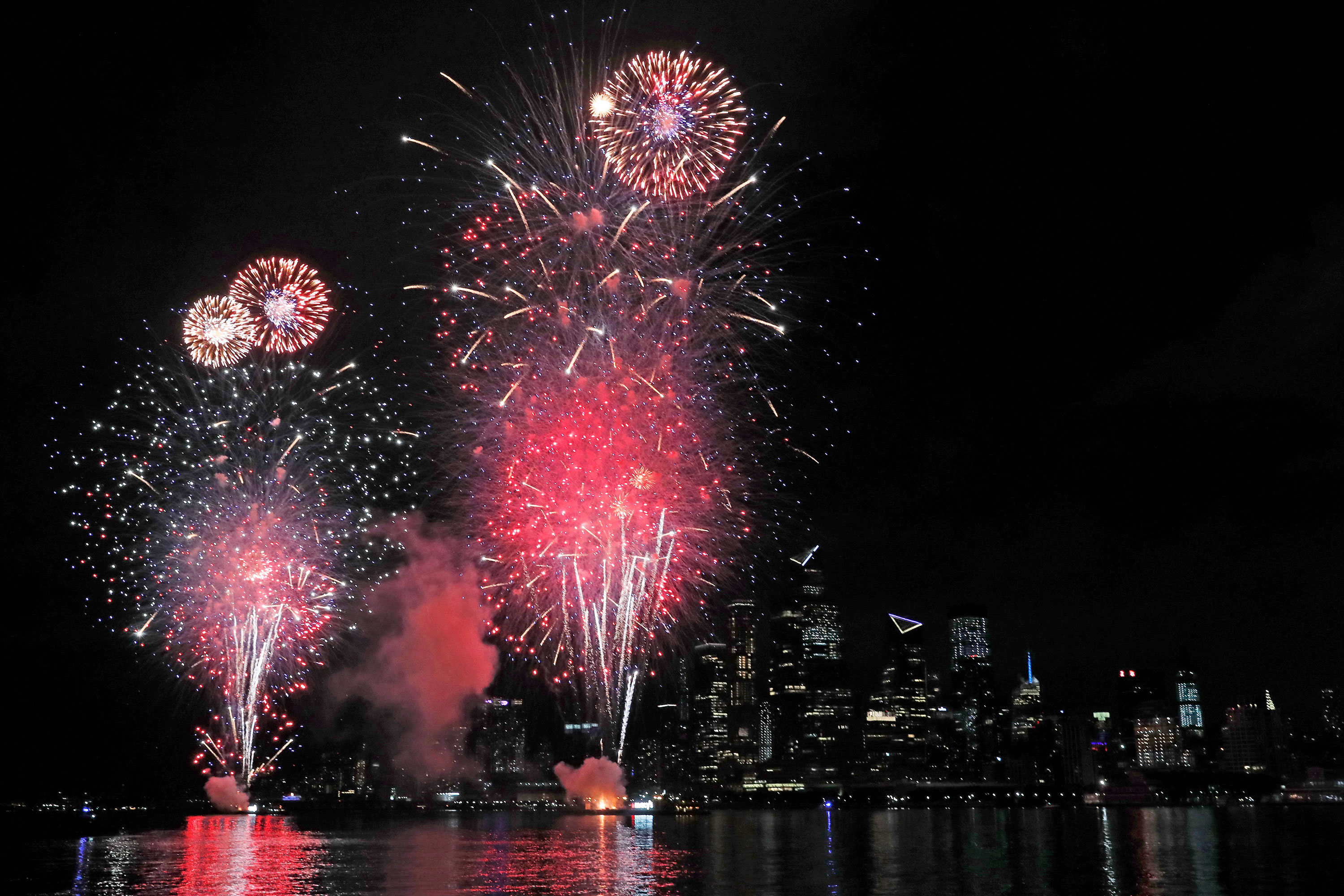 A fireworks display sponsored by Macy's explode over the Hudson Yards area of Manhattan on June 30 in New York.