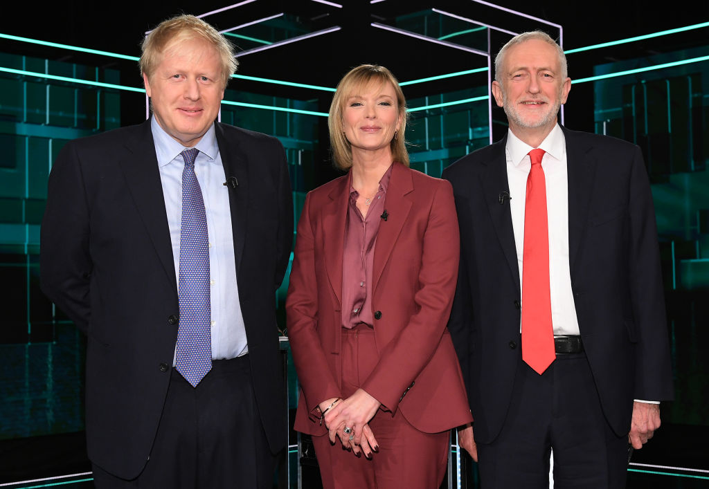Johnson, Corbyn and moderator Julie Etchingham at the start of the debate.