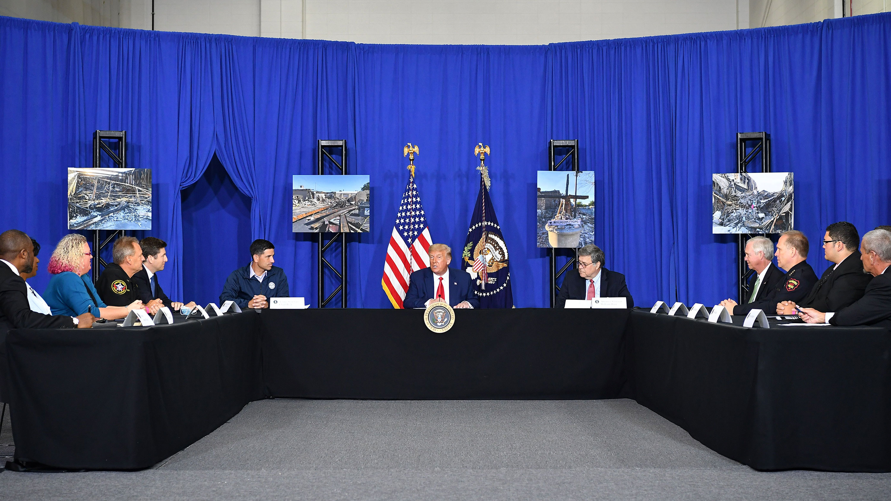 President Donald Trump participates in a roundtable discussion on community safety with other officials in Kenosha, Wisconsin, on September 1.