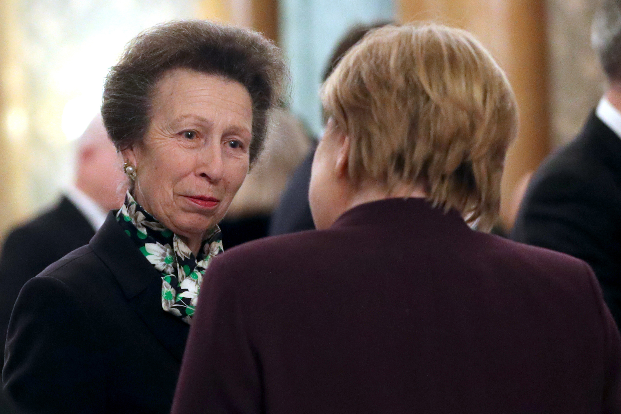 Princess Anne speaks with German Chancellor Merkel at Buckingham Palace on Tuesday evening. Photo: Yui Mok/AFP via Getty Images