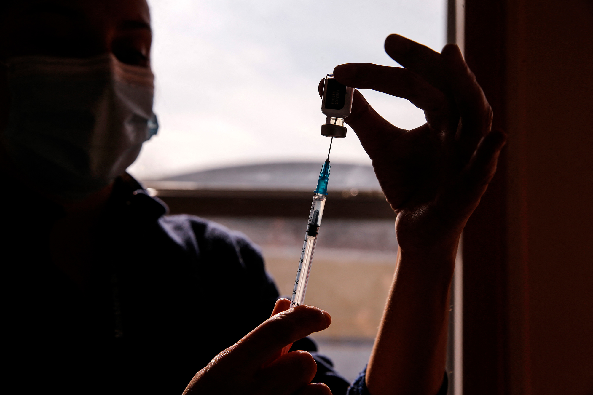 A health workers fills a syringe with a dose of the Pfizer-BioNTech vaccine at a vaccination center in Santiago, Chile, on July 3.