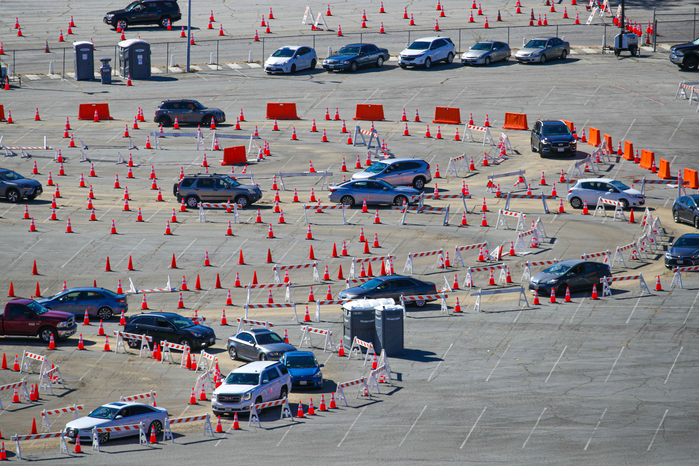 People line up to receive Covid-19 vaccinations at Dodger Stadium in Los Angeles on January 30.