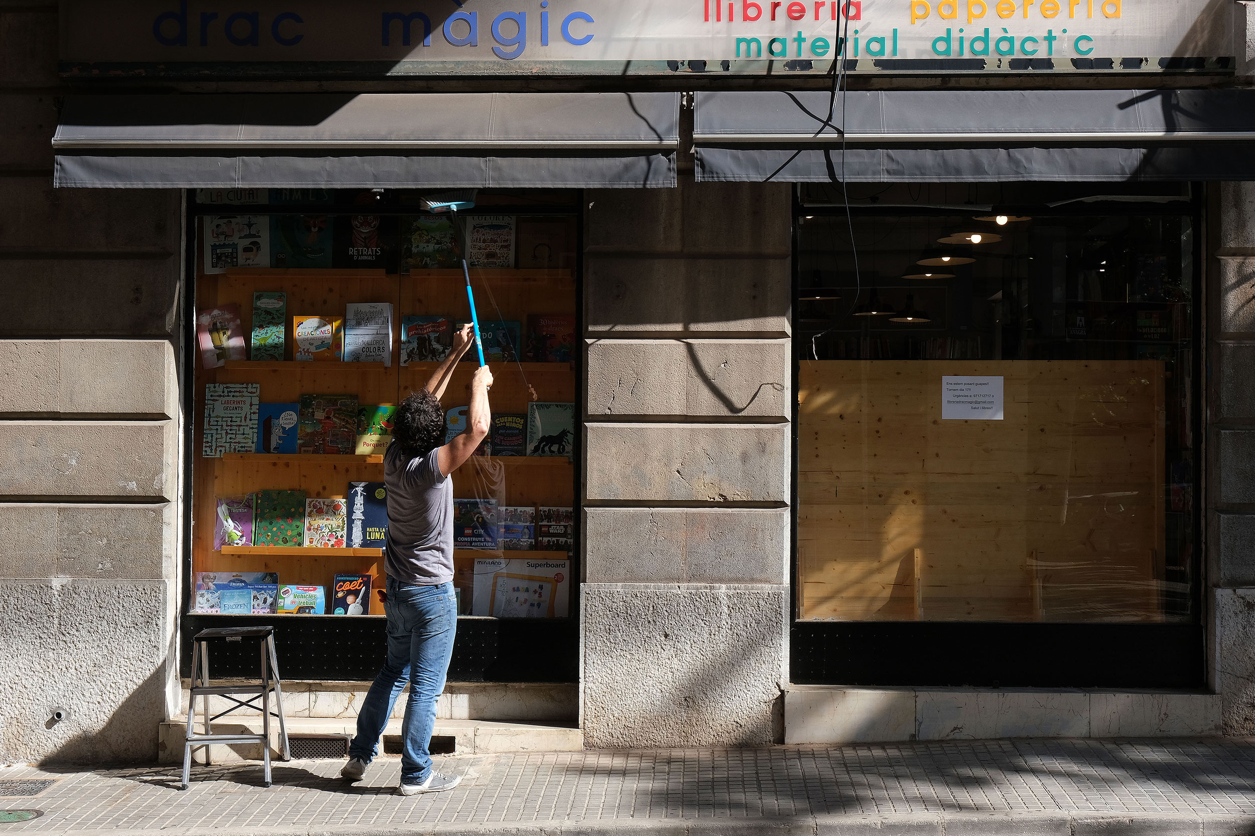 A woman opens her store in Palma de Mallorca during phase one of Spain's reopening.