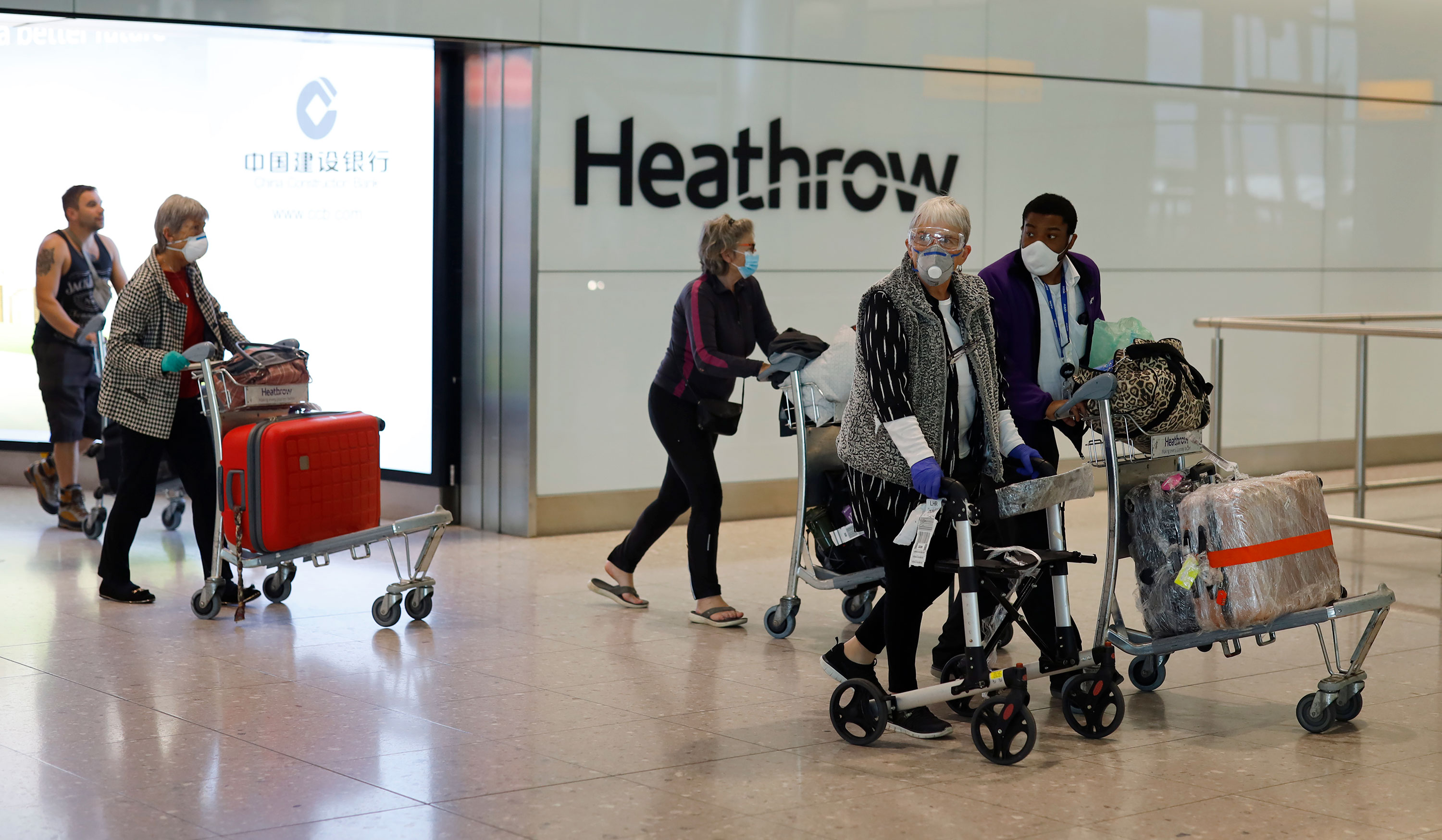 Passengers arrive at Terminal 2 of Heathrow Airport on May 22 in London, England.