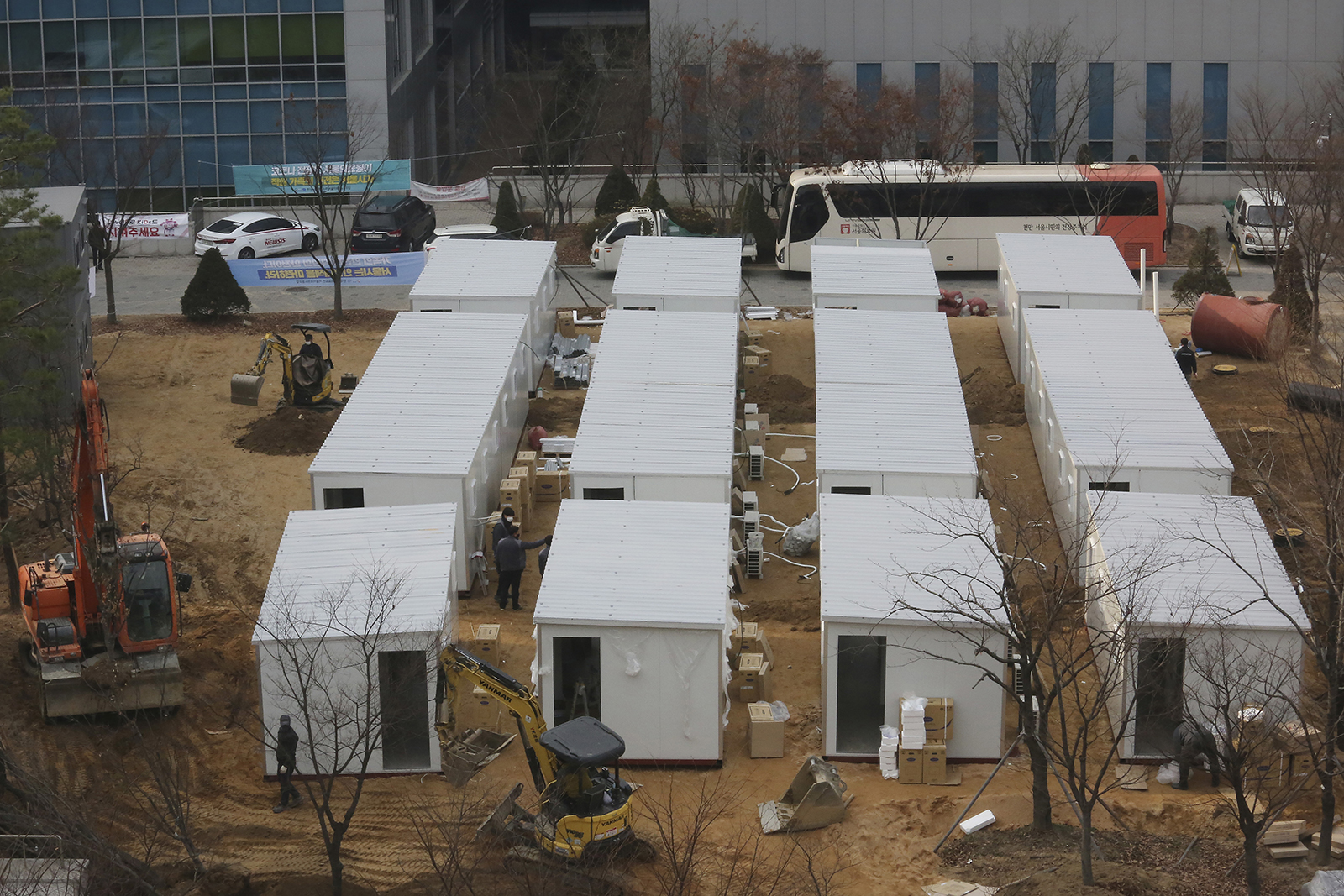 Containers to be used as a ward to treat people infected with the coronavirus are set up on the grounds of the Seoul Medical Center in Seoul, South Korea, on Thursday, December 10.