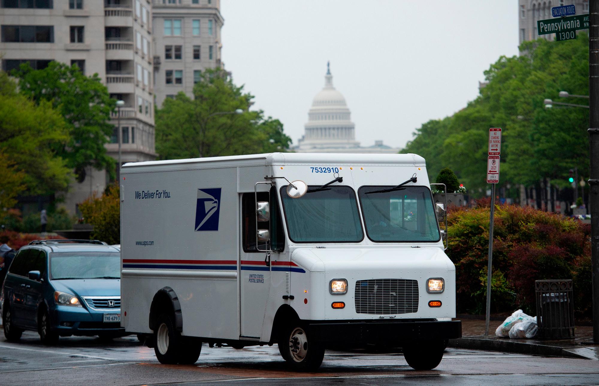 A US Postal Service truck drives down Pennsylvania Avenue in Washington, DC, on April 23.