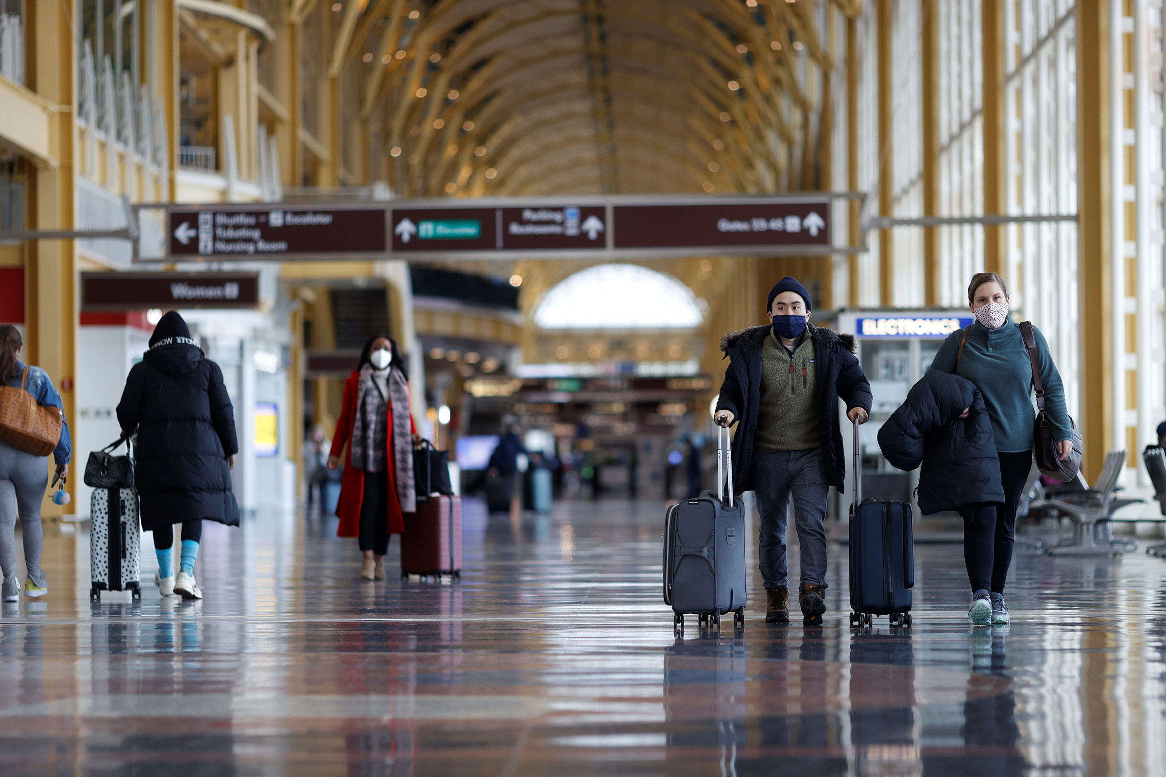 Travelers walk through Reagan National Airport in Arlington, Virginia, on February 2.