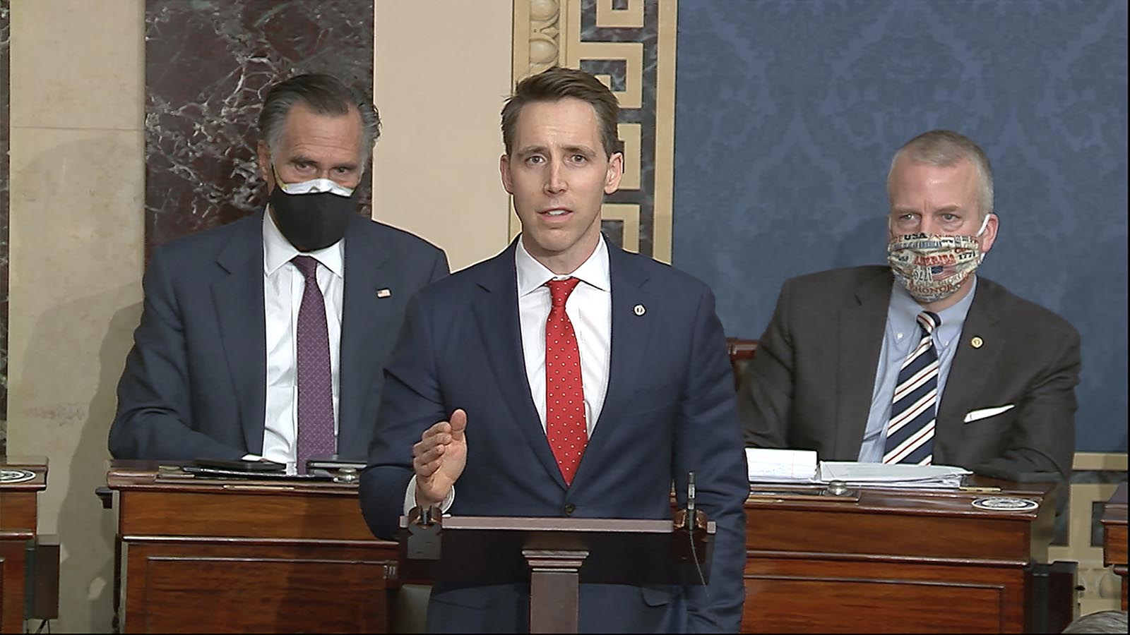In this image from video, Sen. Josh Hawley of Missouri speaks as the Senate reconvenes to debate the objection to confirm the Electoral College Vote from Arizona, after protesters stormed into the U.S. Capitol on Wednesday, January 6.