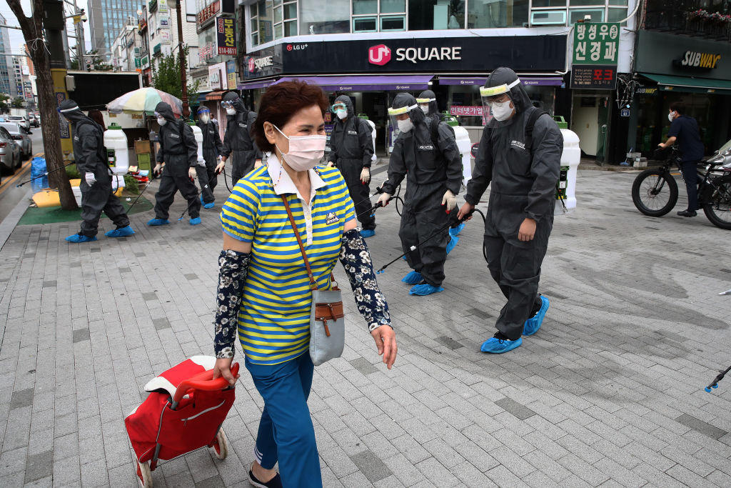 Health officials spray anti-septic solution in markets and shopping districts on September 17 in Incheon, South Korea.