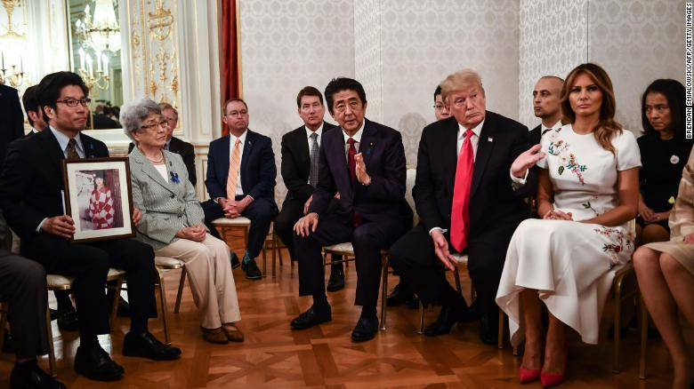 US President Donald Trump and First Lady Melania Trump are accompanied by Japan's Prime Minister Shinzo Abe during a meeting with families who have had relatives abducted by North Korea, at Akasaka Palace in Tokyo on May 27, 2019.
