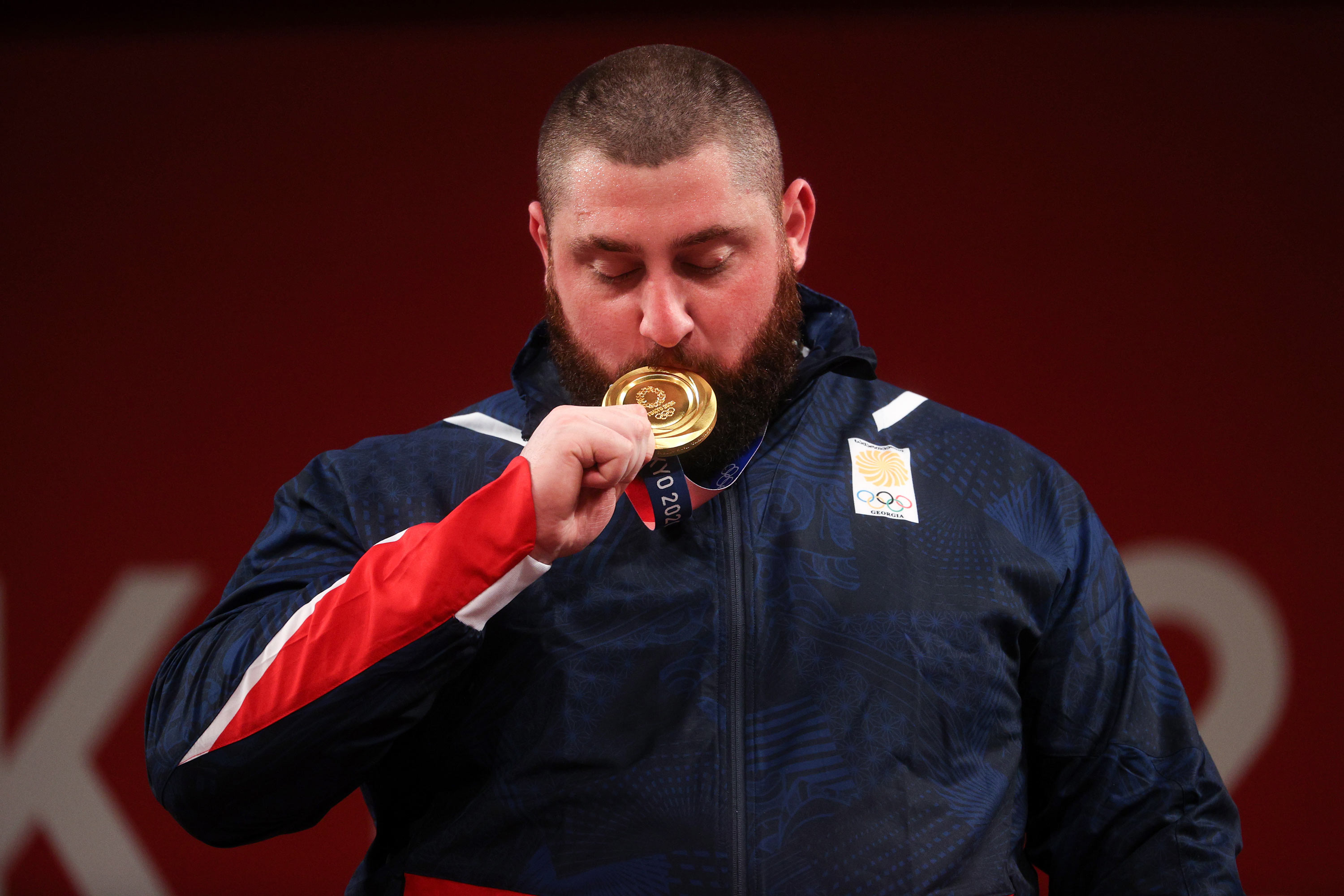 Georgia's Lasha Talakhadze poses with his gold medal in the 109kg+ weightlifting event on August 4.