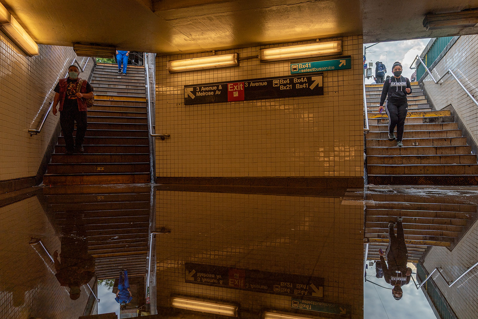 Commuters walk into a flooded subway station in New York on September 2.