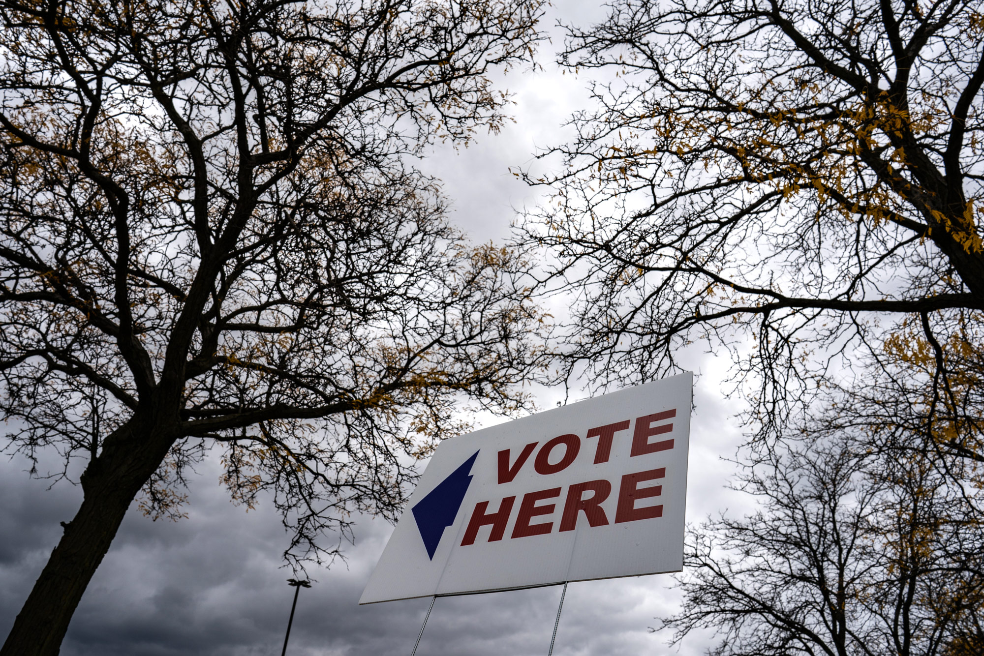 A sign is seen outside one of the Satellite Voting Center at Adams-Butzel Recreational Complex in Detroit, Michigan on October 15.