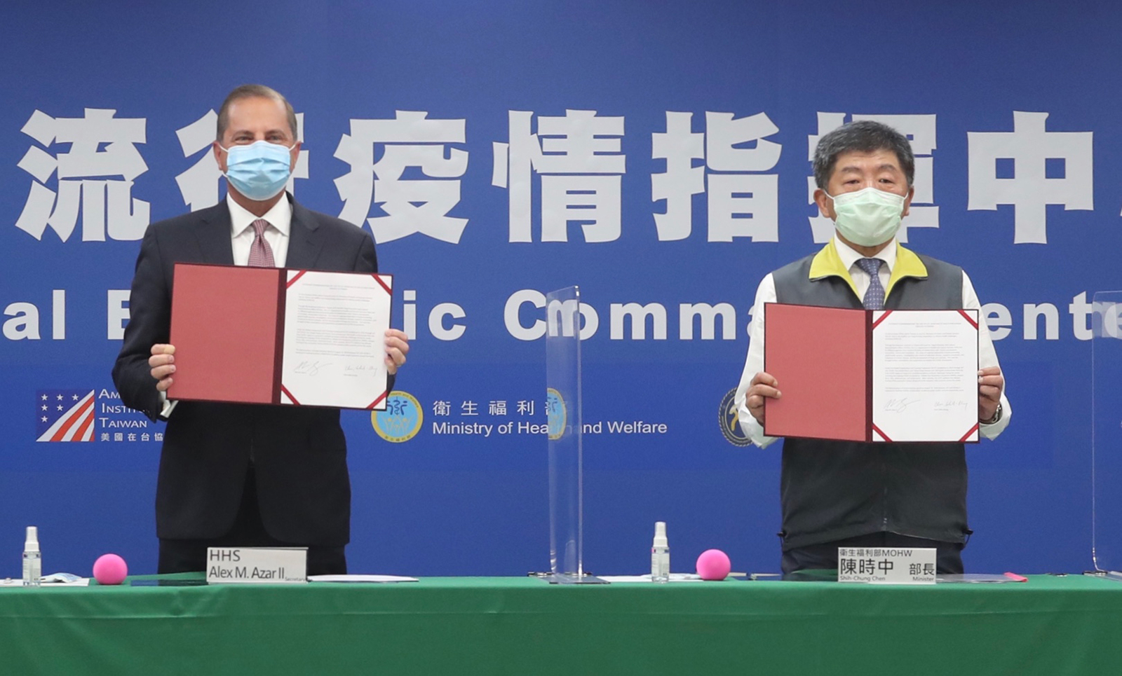 US Health Secretary and Human Rights Services Alex Azar (left) and Taiwan's Minister of Health and Welfare Chen Shih-chung display the signed documents during a memorandum of understanding signing ceremony at the Centers for Disease Control (CDC) in Taipei, Taiwan, on August 10.