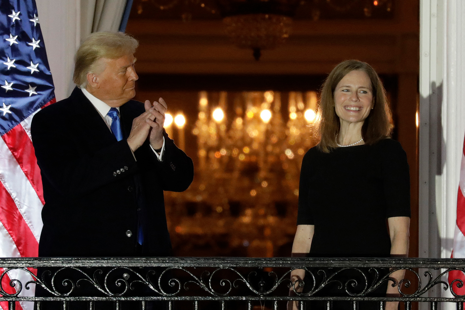 President Donald Trump applauds new Supreme Court Associate Justice Judge Amy Coney Barrett after she was sworn-in during a ceremony on the South Lawn of the White House in Washington, DC, on October 26.