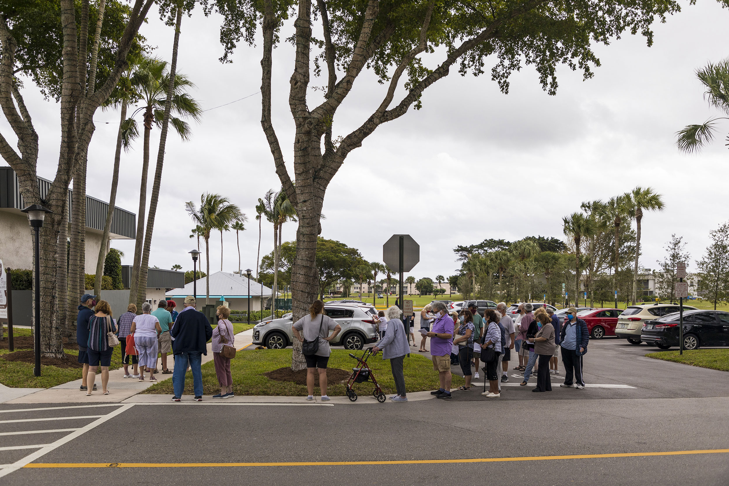 Residents wait in line to receive Covid-19 vaccinations at the King's Point retirement home in Delray Beach, Florida, on December 30.