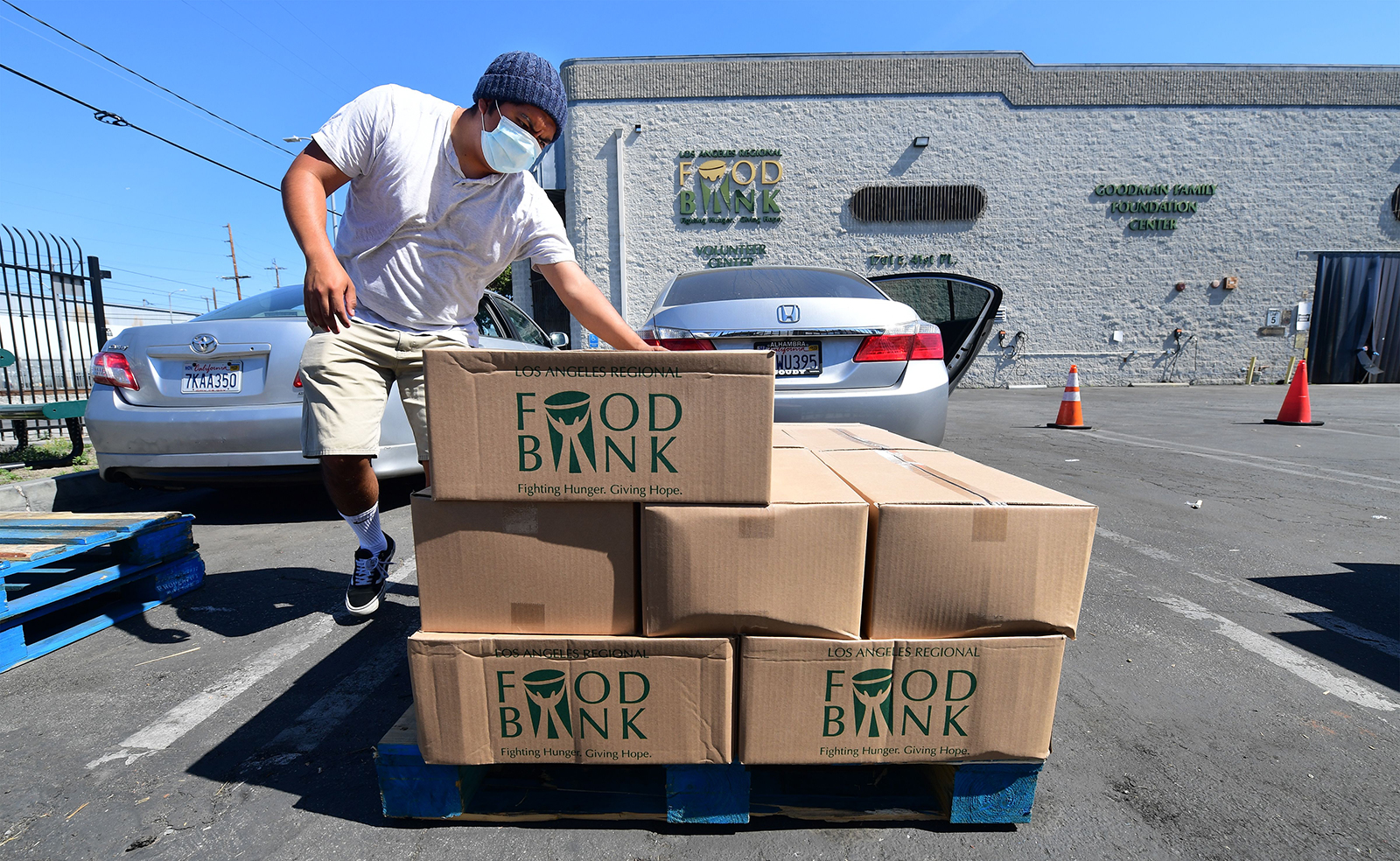 People load their vehicles with boxes of food at a Los Angeles Regional Food Bank on May 5, in Los Angeles, California. Food Banks across the United States are seeing numbers and people they have never seen before amid unprecedented unemployment.