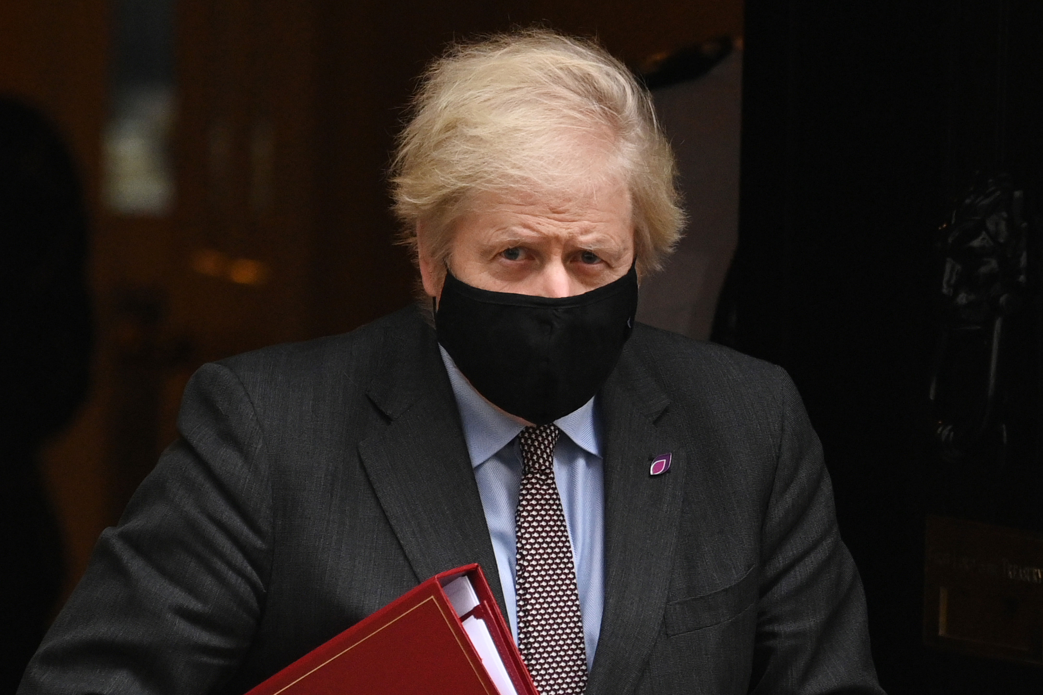 UK Prime Minister Boris Johnson leaves Downing Street in London on January 27.