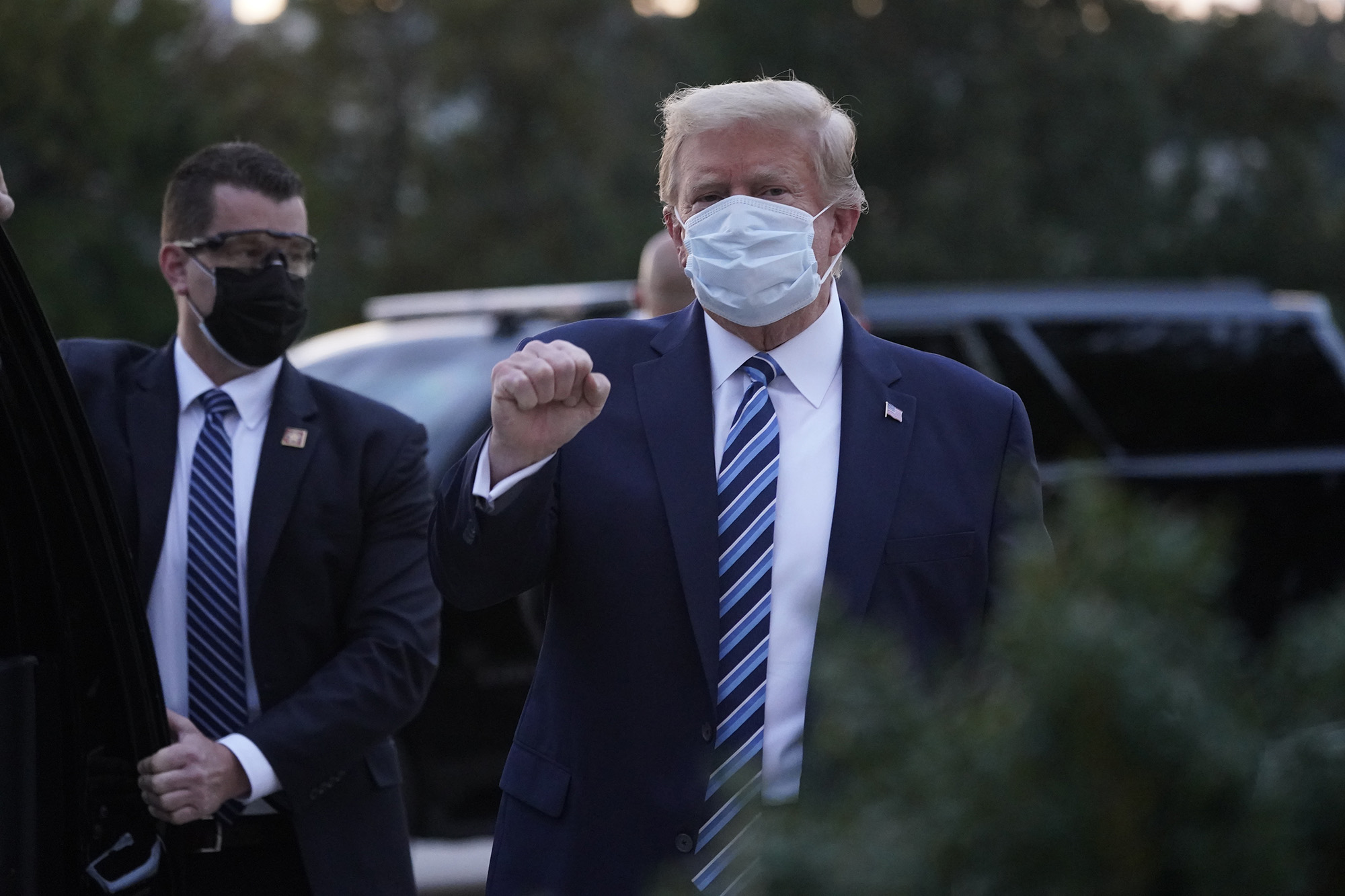 US President Donald Trump gestures outside Walter Reed National Military Medical Center in Bethesda, Maryland, on October 5.