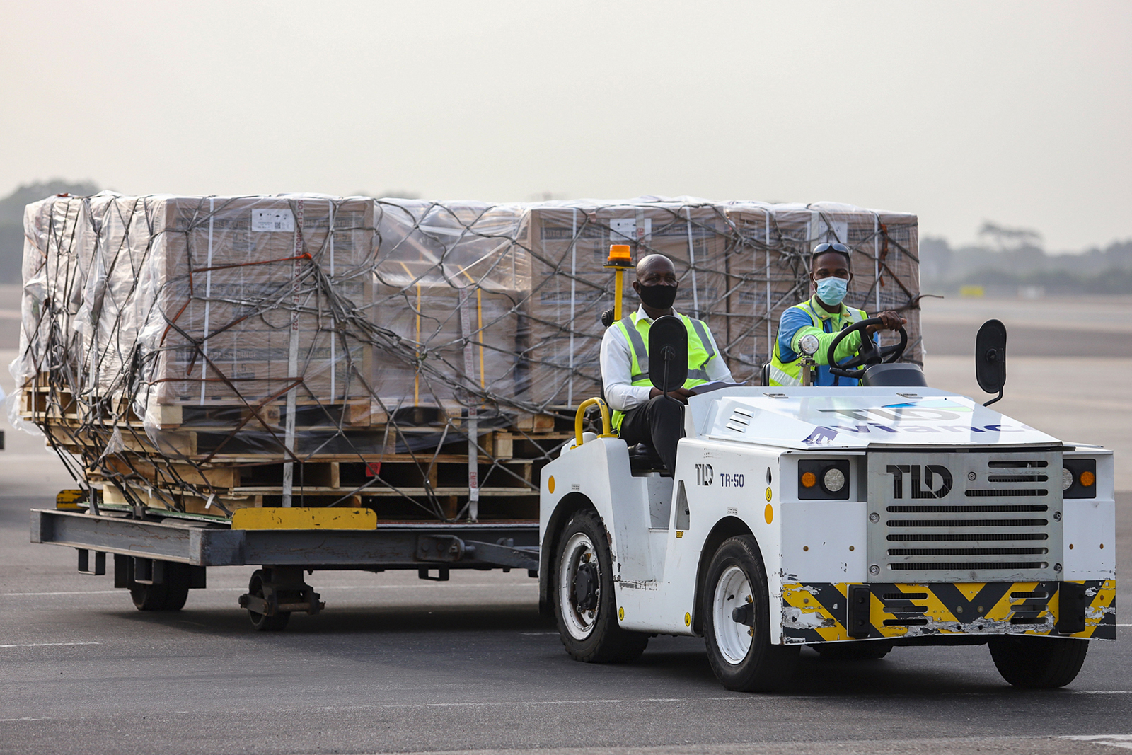 Airport workers transport a shipment of Covid-19 vaccines at the Kotoka International Airport in Accra, Ghana, on February 24