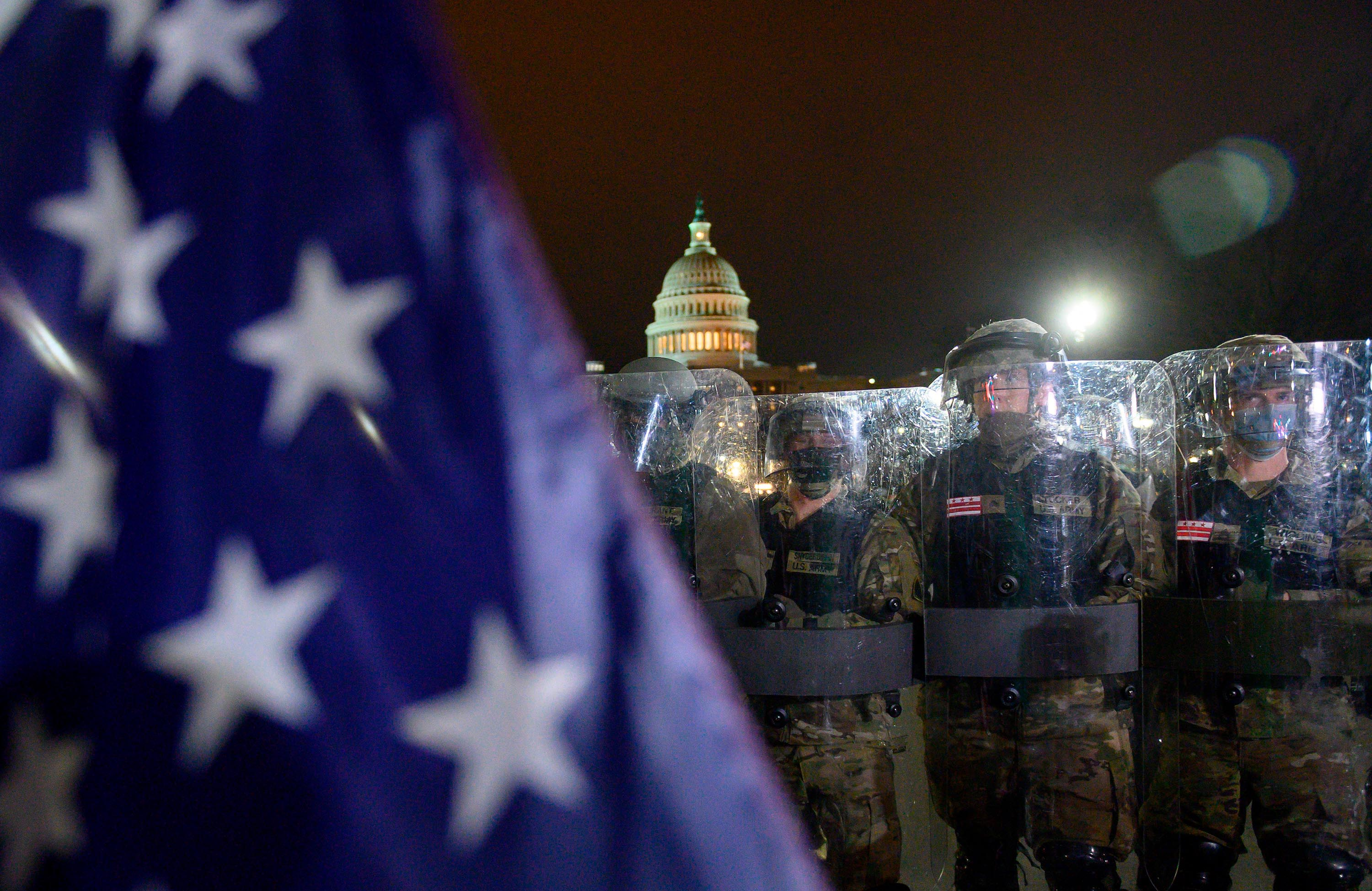 Members of the DC National Guard are deployed outside of the US Capitol in Washington DC on January 6, 2021.