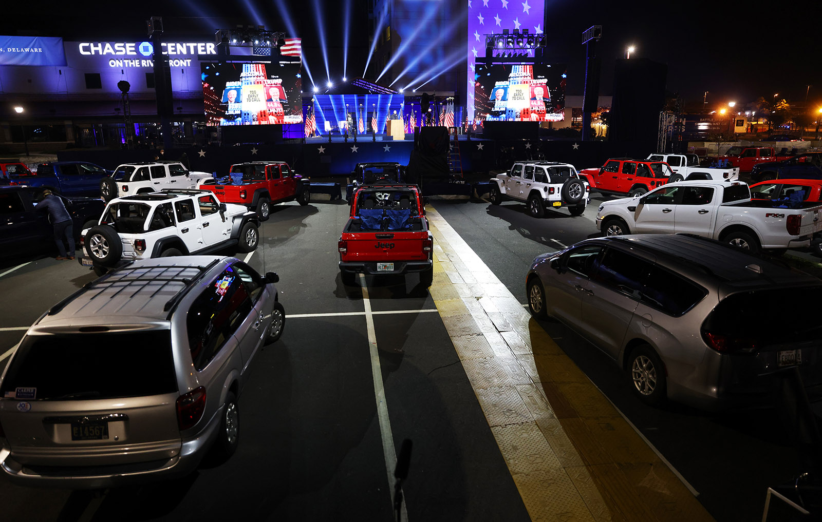 Vehicles sit parked at a drive-in election night event for Democratic presidential nominee Joe Biden at the Chase Center on November 3, in Wilmington, Delaware.