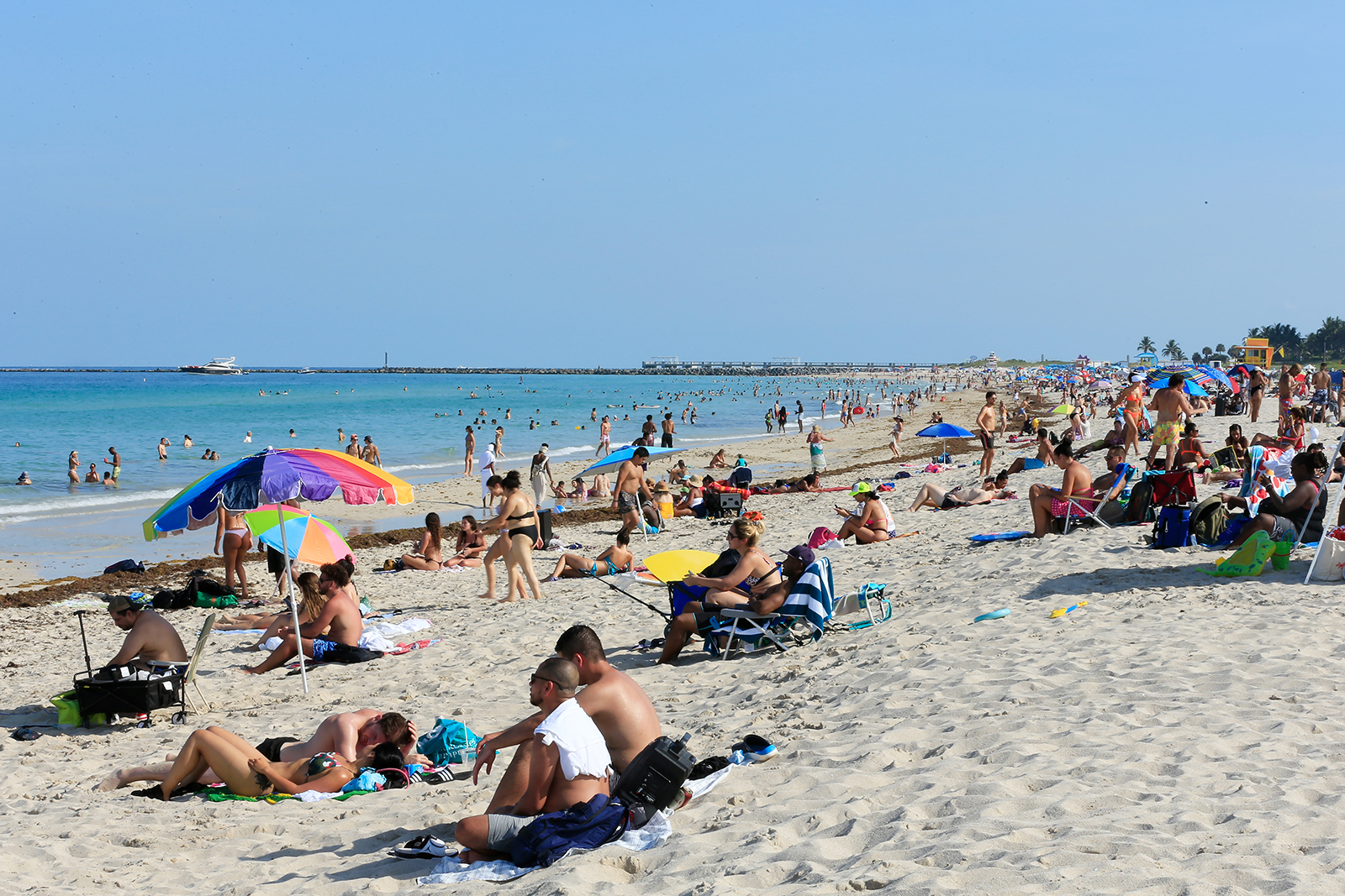 Beachgoers take advantage of the opening of South Beach in Miami Beach, Florida, on June 10.
