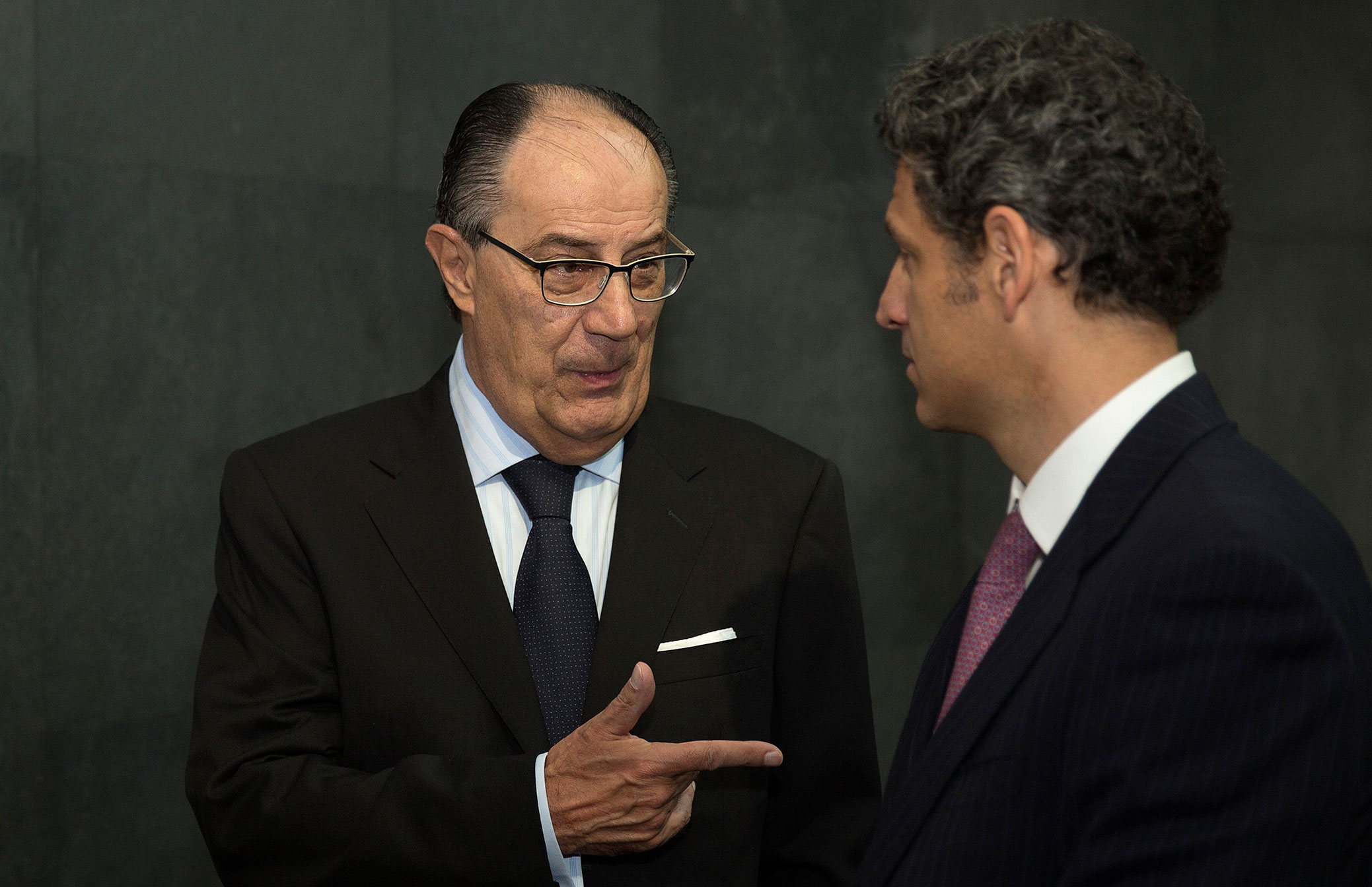 Jaime Ruiz Sacristan, center, speaks with Francisco del Valle Perochena, chairman of Elementia SA, during the opening bell ceremony at the Bolsa Mexicana de Valores in Mexico City, Mexico, July 23, 2015.