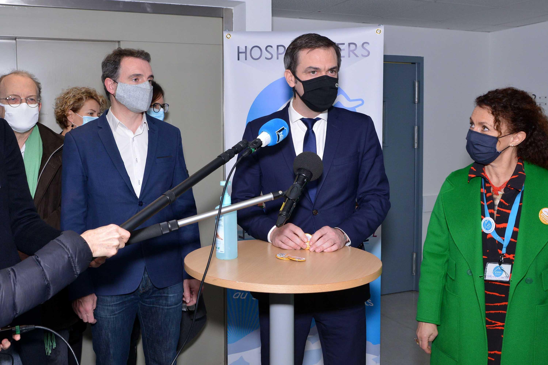 French Health Minister Olivier Veran, center, speaks during a visit to the University Hospital 'CHU Grenoble Alpes' in Grenoble, France, on January 18.