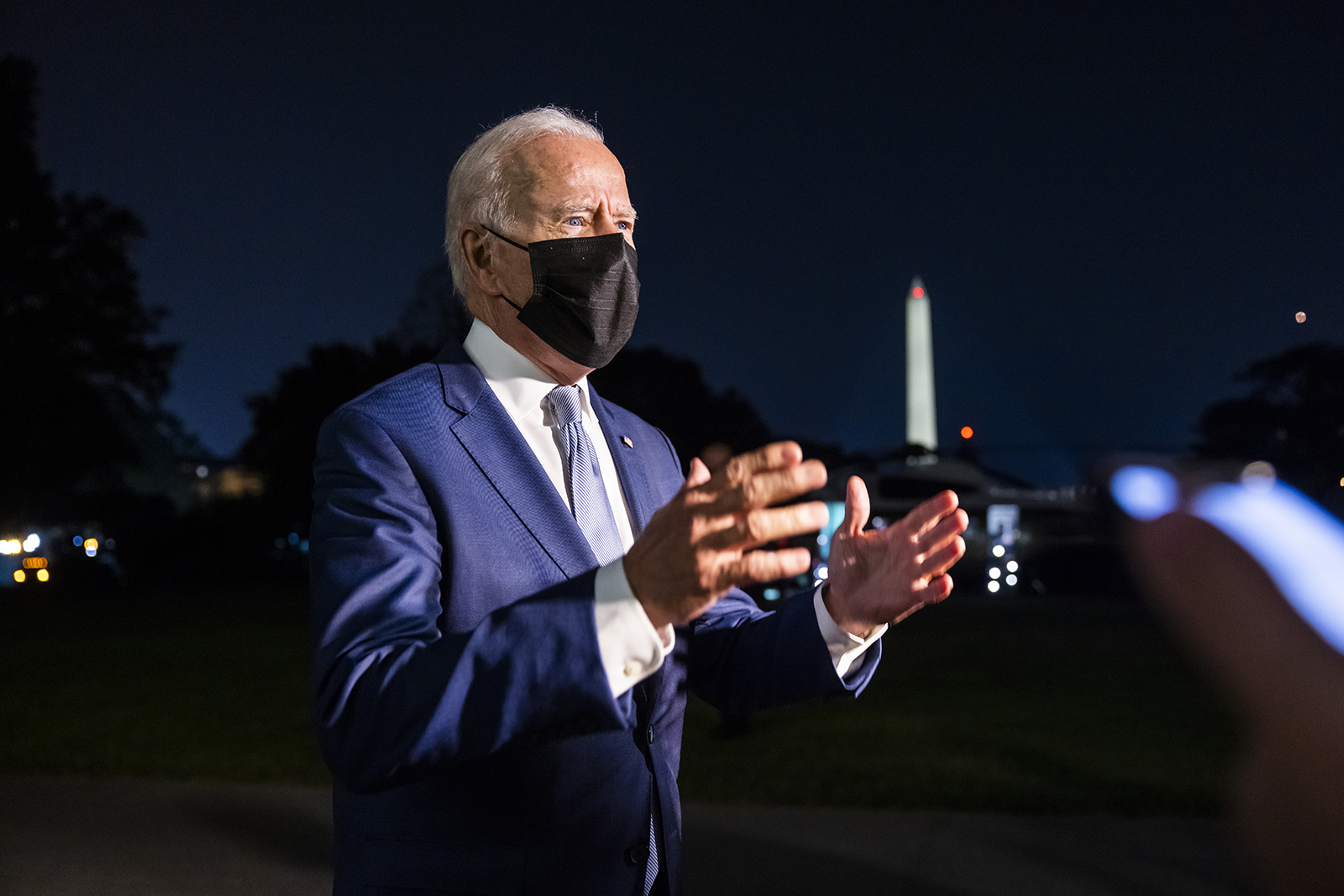 President Joe Biden speaks to members of the media after he arrived on the South Lawn of the White House in Washington on Tuesday.