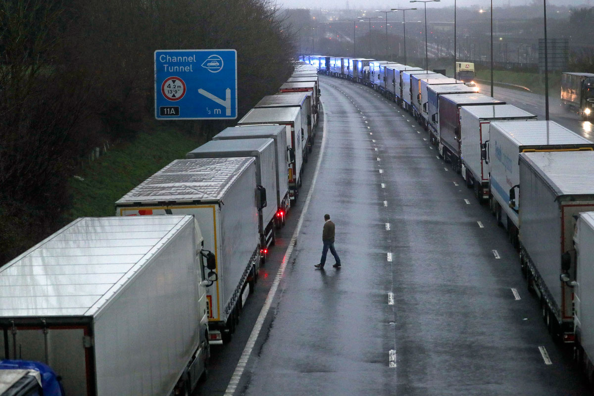 Lorries are parked on the M20 near Folkestone, Kent, England as part of Operation Stack after the Port of Dover was closed and access to the Eurotunnel terminal suspended on December 21.