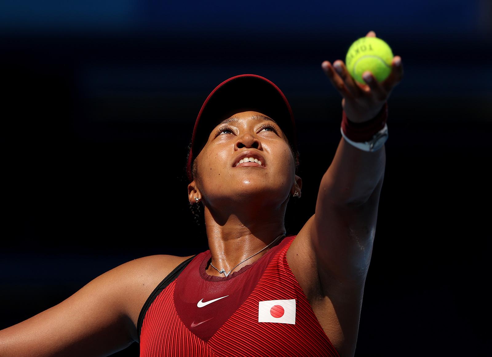 Japan's Naomi Osaka serves during her single's match against China's Saisai Zheng on July 25.