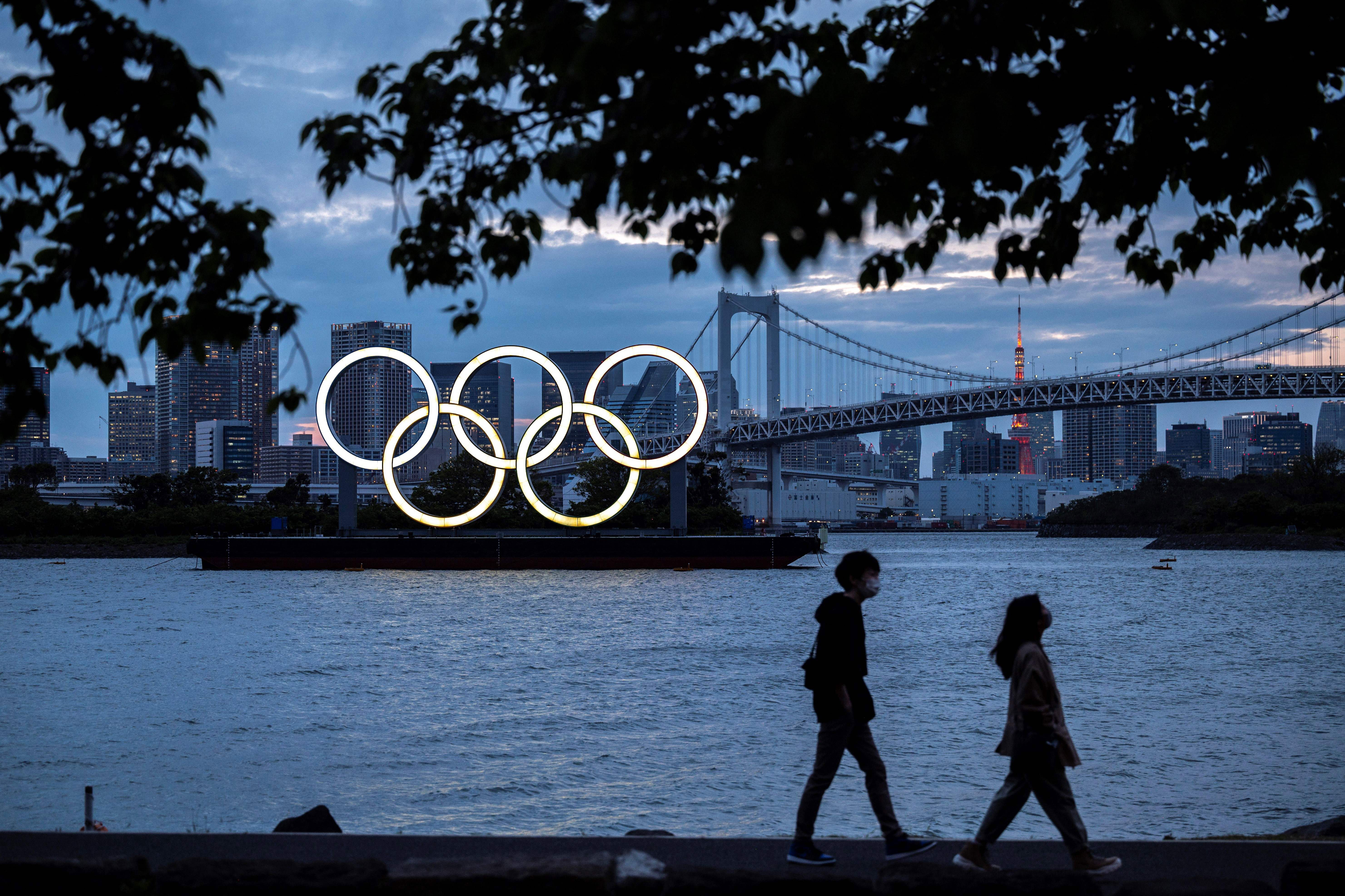 The Olympic rings are lit up at dusk on the Odaiba waterfront in Tokyo on April 28.