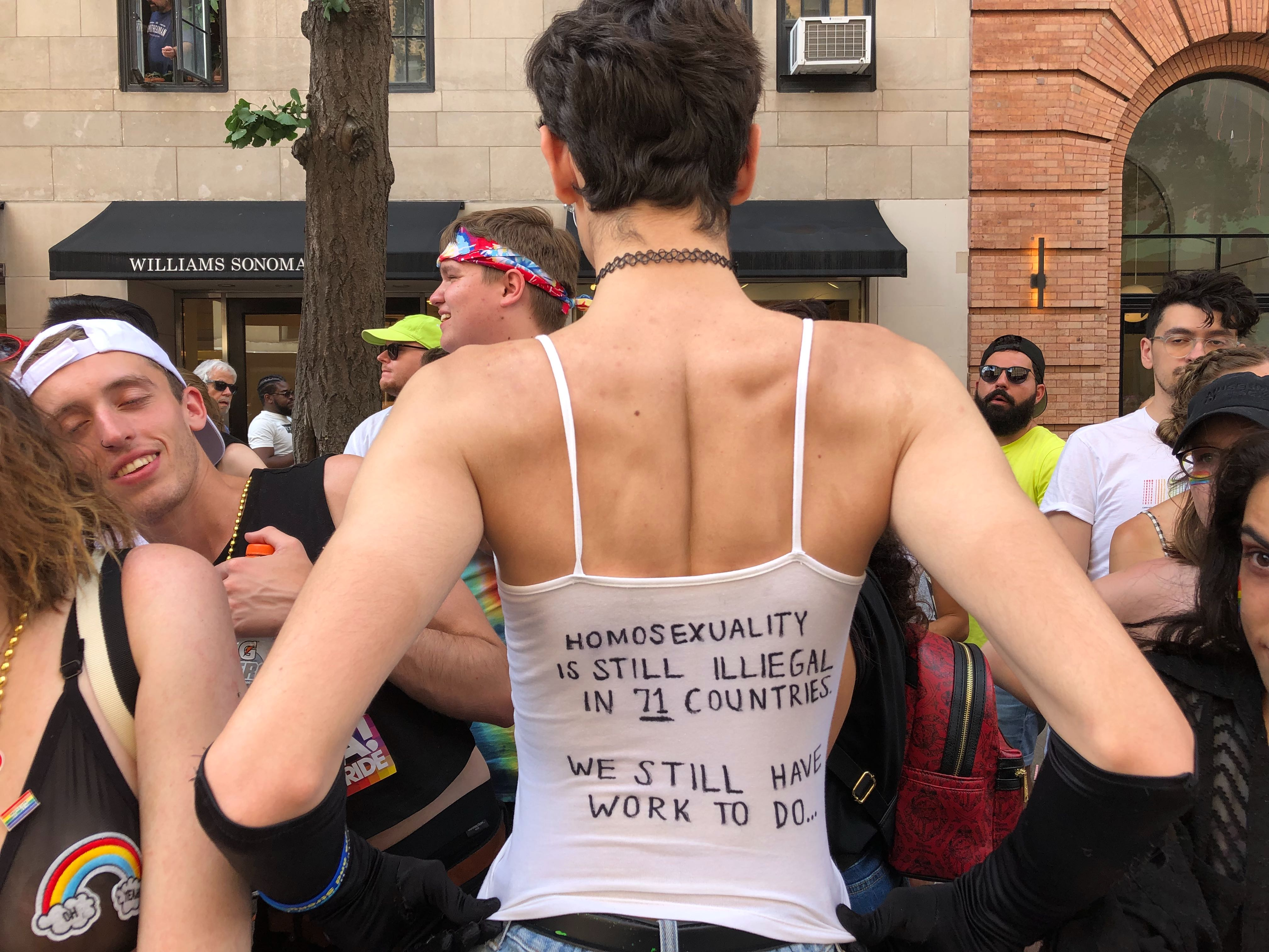 """The back of Stephen Carella's shirt reads """"Homosexuality is still illegal in 71 countries. We still have work to do."""""""