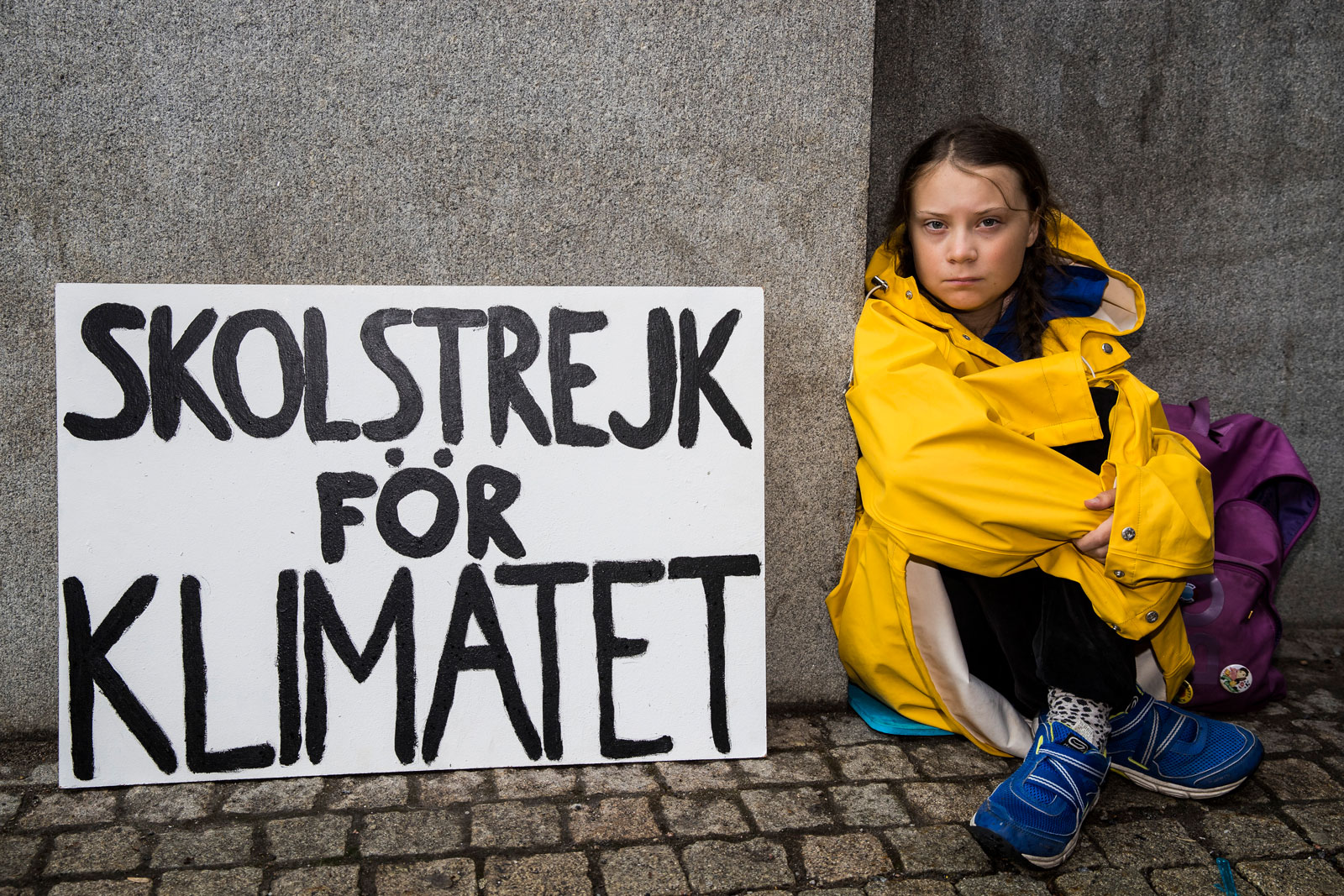 Thunberg leads a school strike and sits outside of Riksdagen, the Swedish parliament building, in order to raise awareness for climate change on August 28, 2018 in Stockholm, Sweden.
