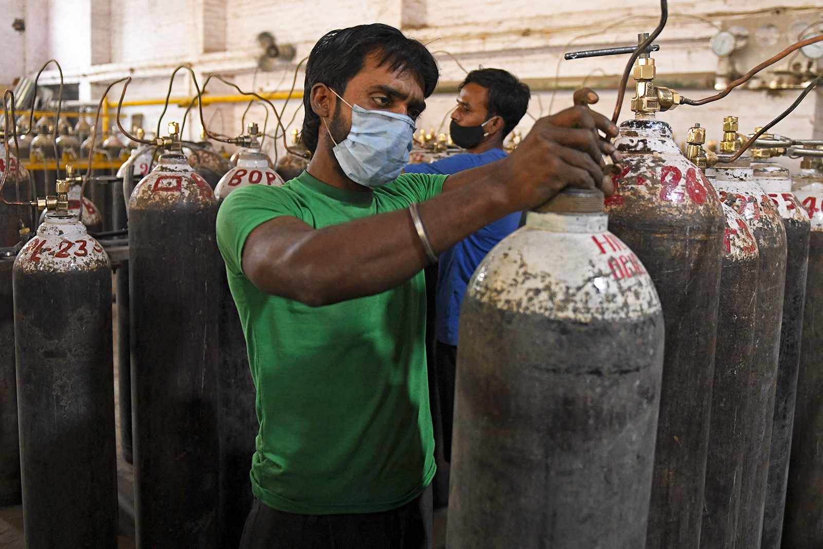 Workers are seen sorting oxygen cylinders that are being used for Covid-19 patients before dispatching them to hospitals at a facility on the outskirts of Amritsar, India, on April 28.