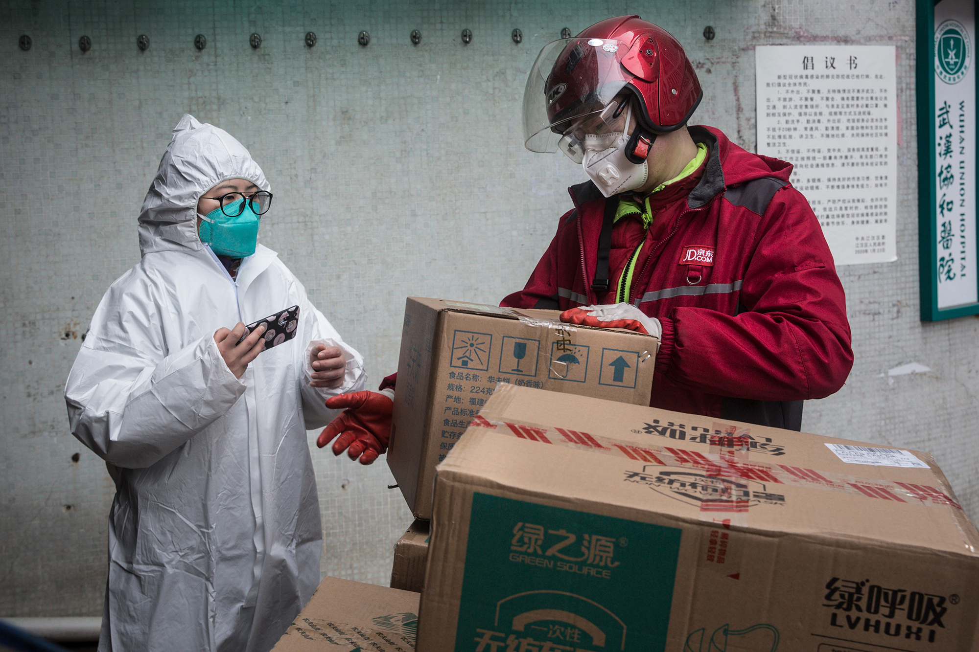 A courier delivers supplies to the Wuhan Union Hospital on January 29 in Wuhan.