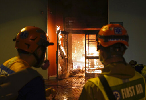 First aid volunteers try to extinguish a fire set by local residents in Fanling on Sunday.