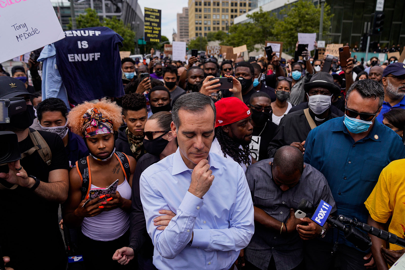 Los Angeles Mayor Eric Garcetti stands with protesters in downtown Los Angeles outside of City Hall on Tuesday, June 2.